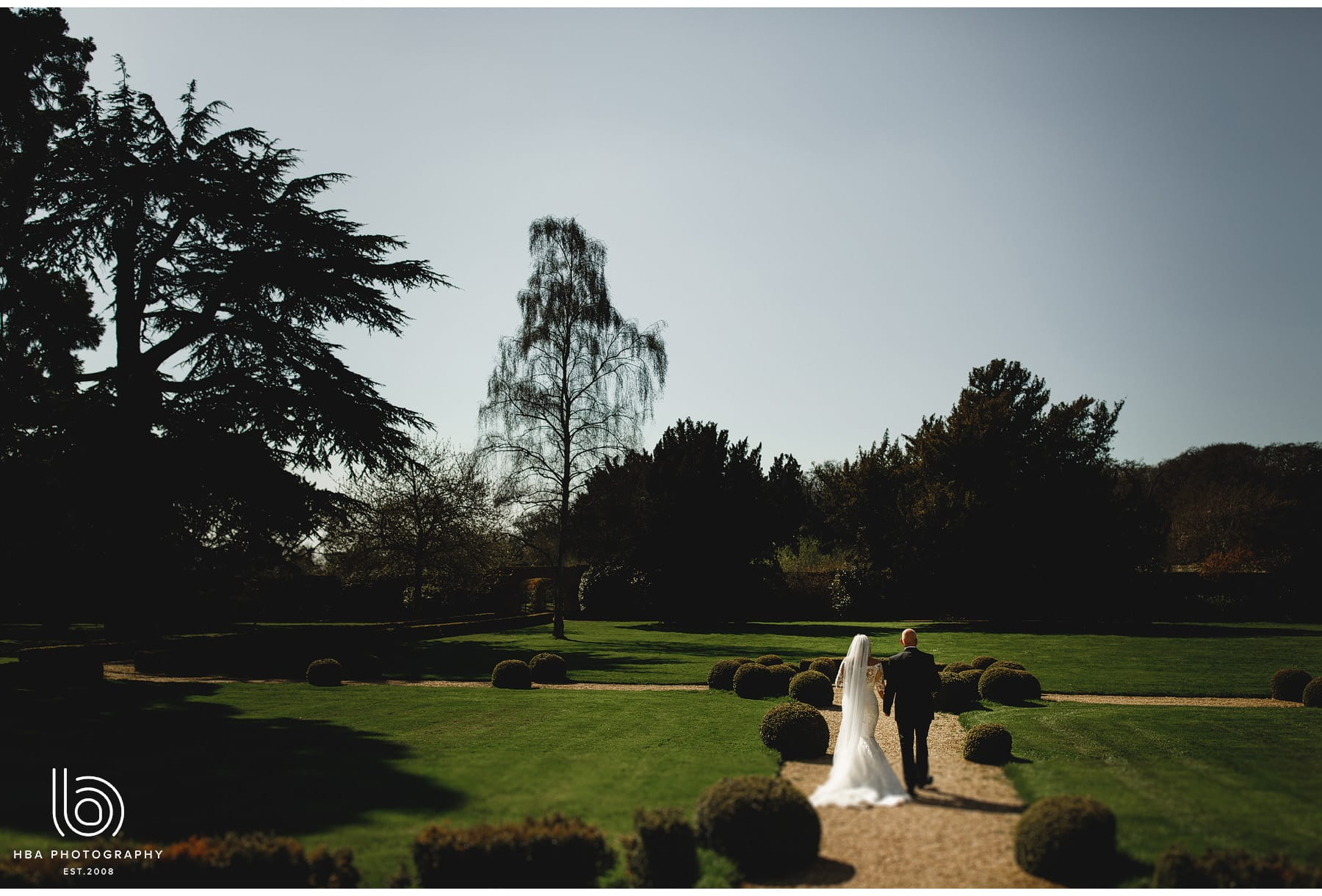 the bride & groom talking a walk