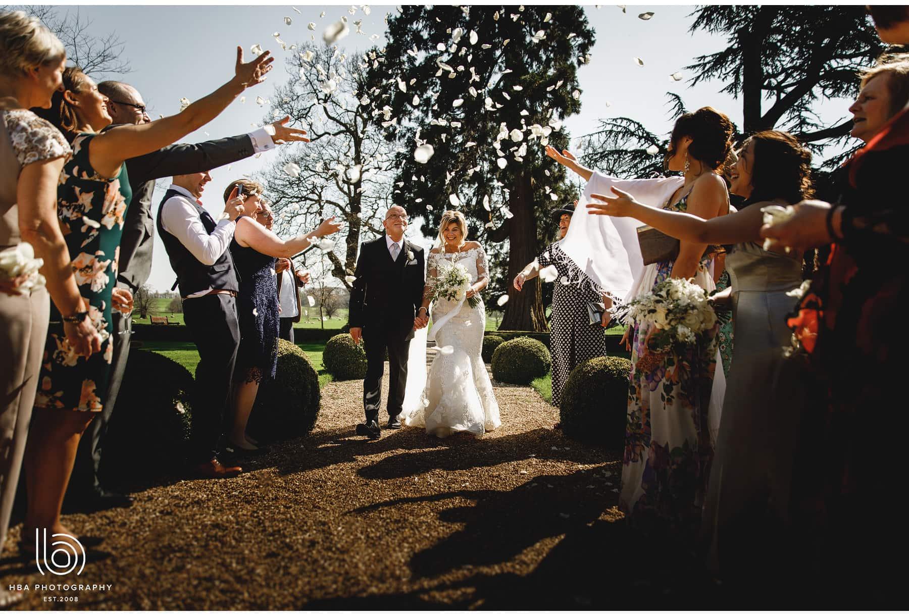 the bride & groom in the confetti tunnel