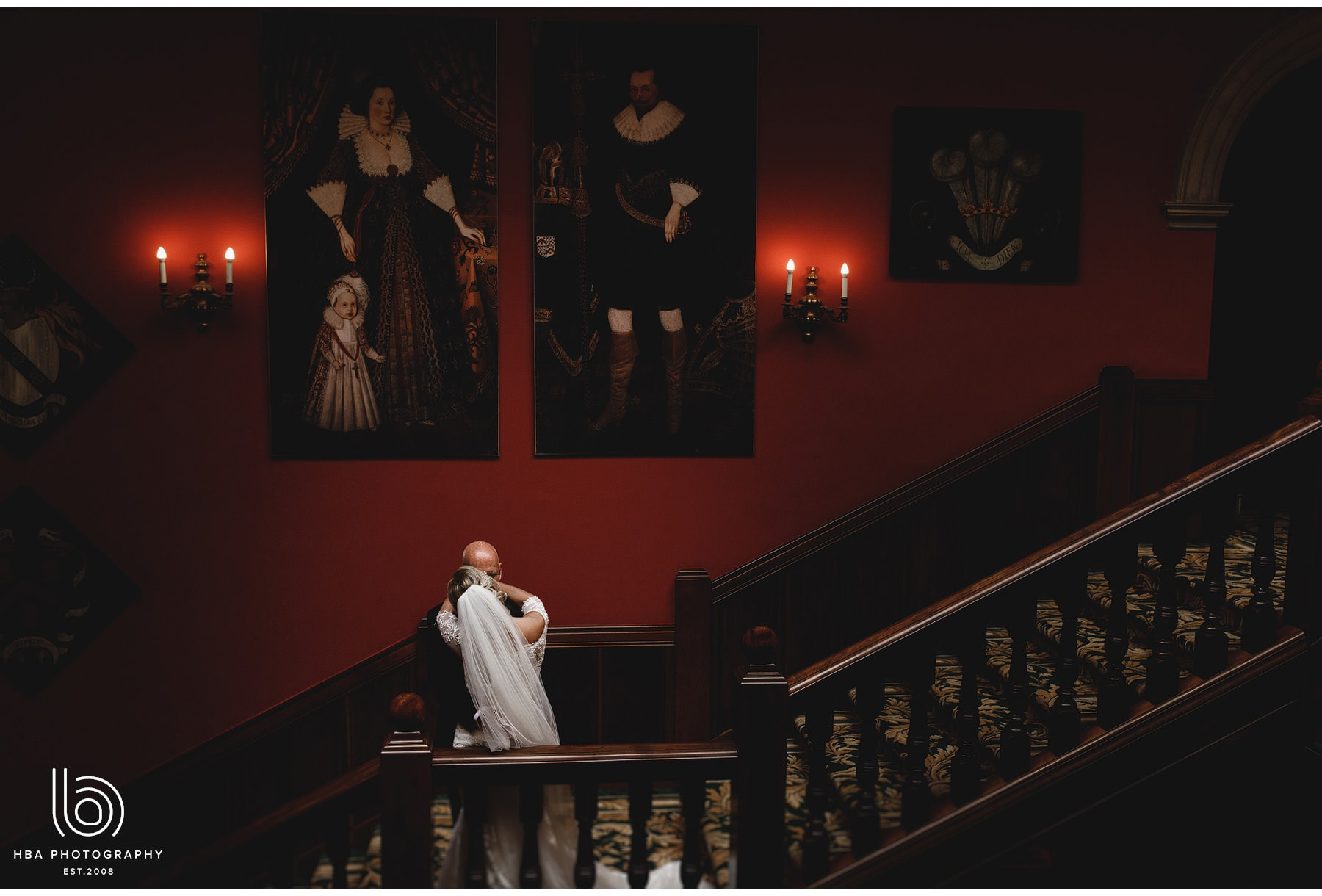 the bride & groom on the stairs at Stapleford Park
