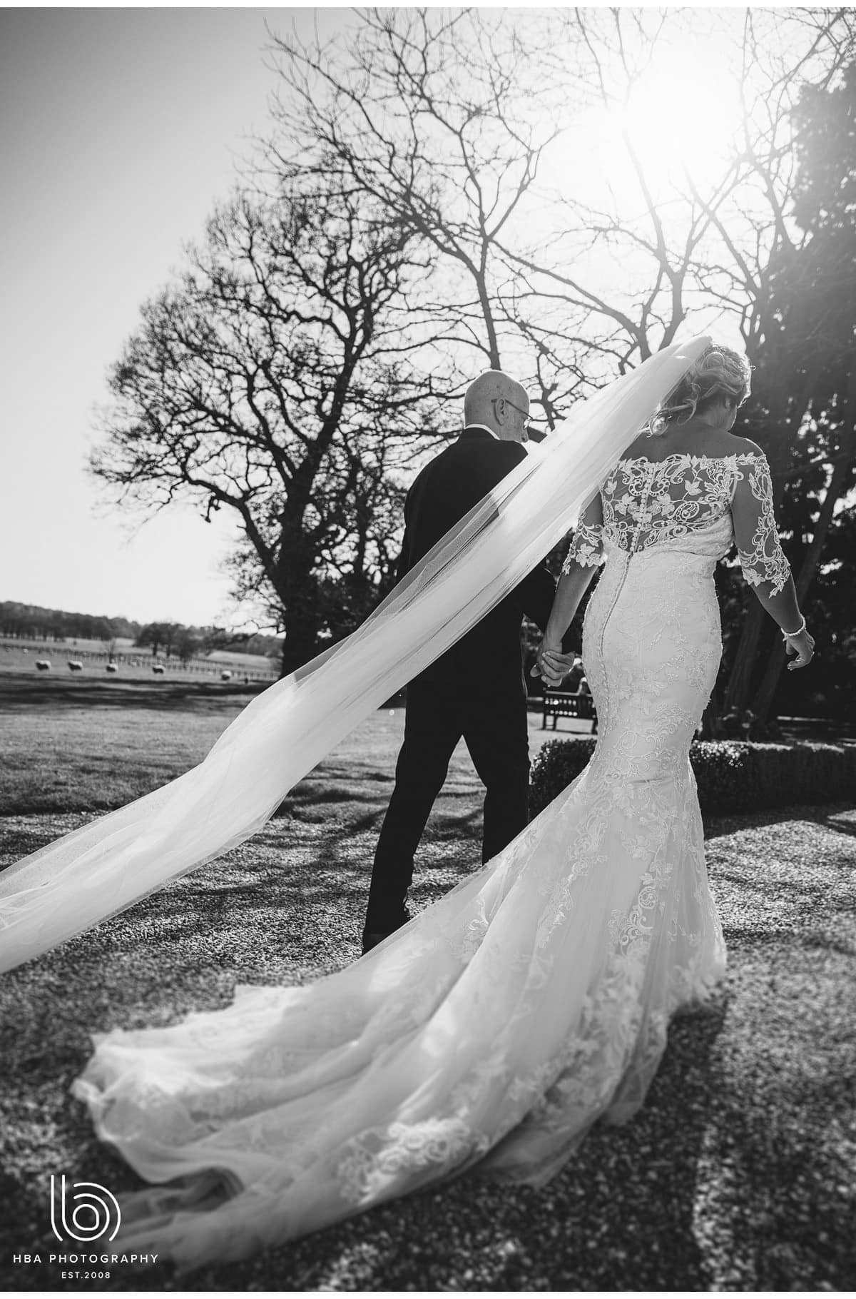 the bride & groom walking in the grounds