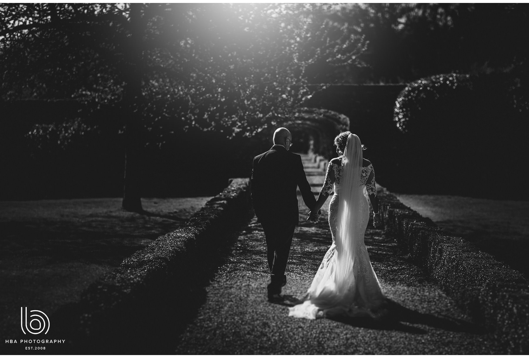the bride & groom with the sun flaring