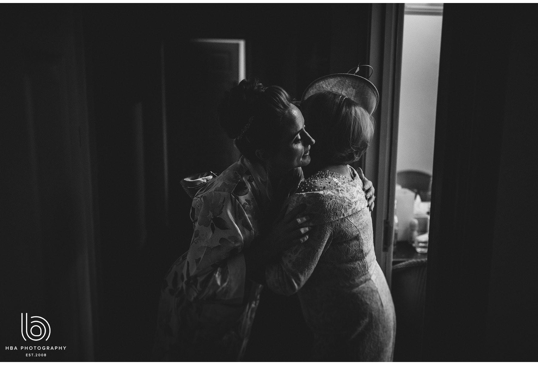 the bride hugging her mum