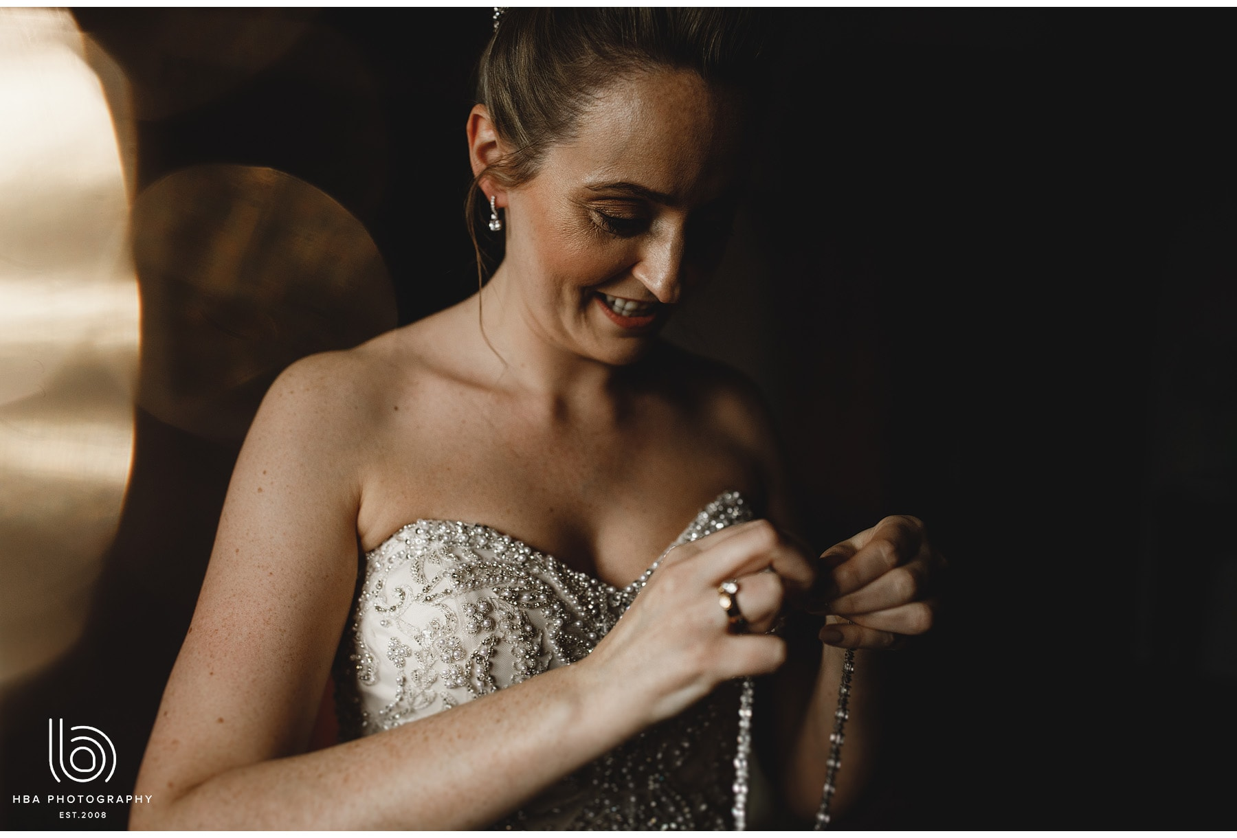 the bride putting on her necklace