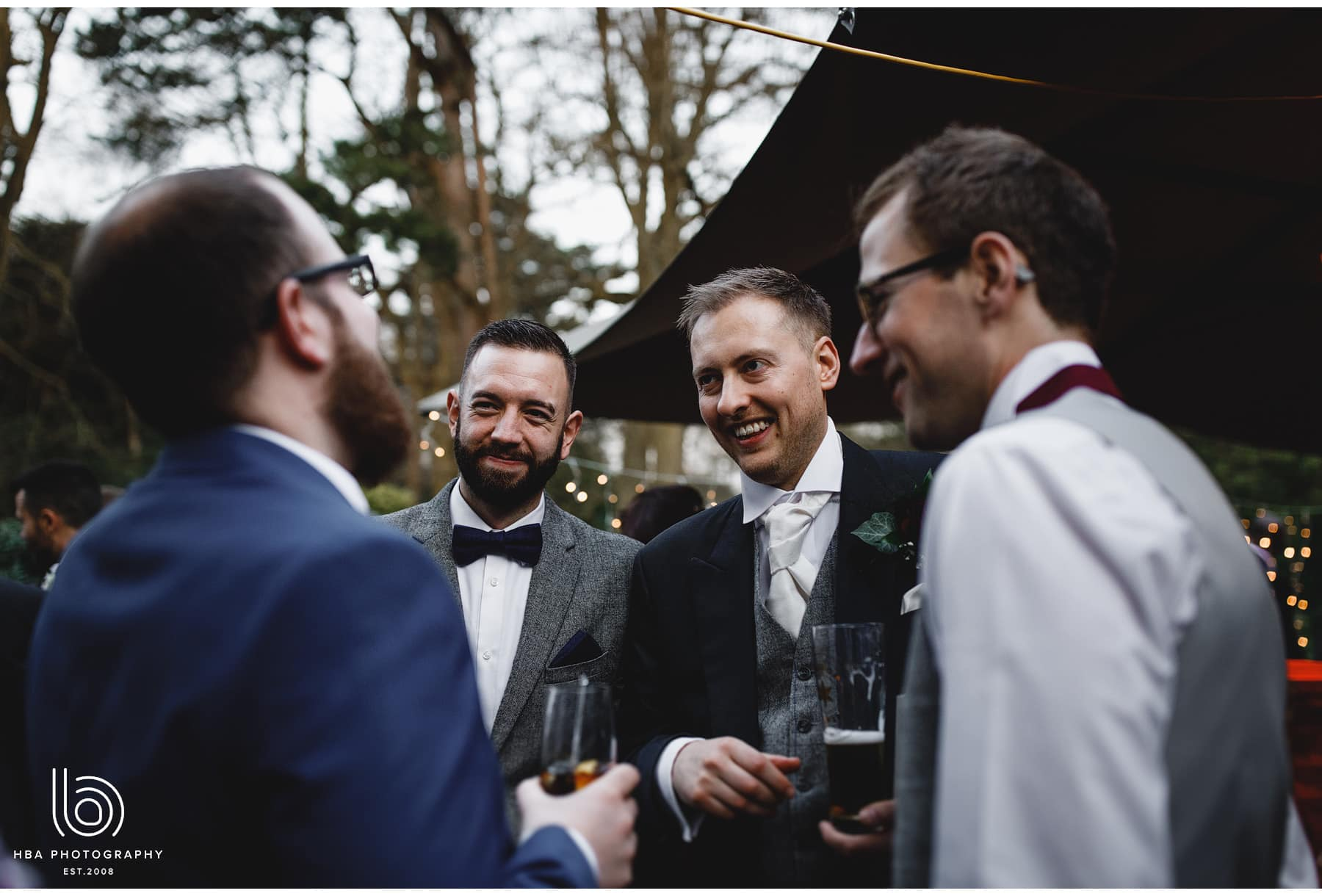 the groom laughing with friends