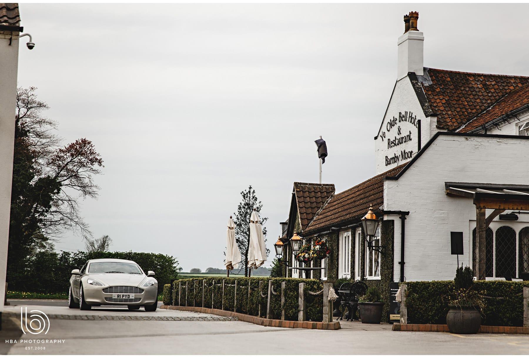 the Aston Martin arriving
