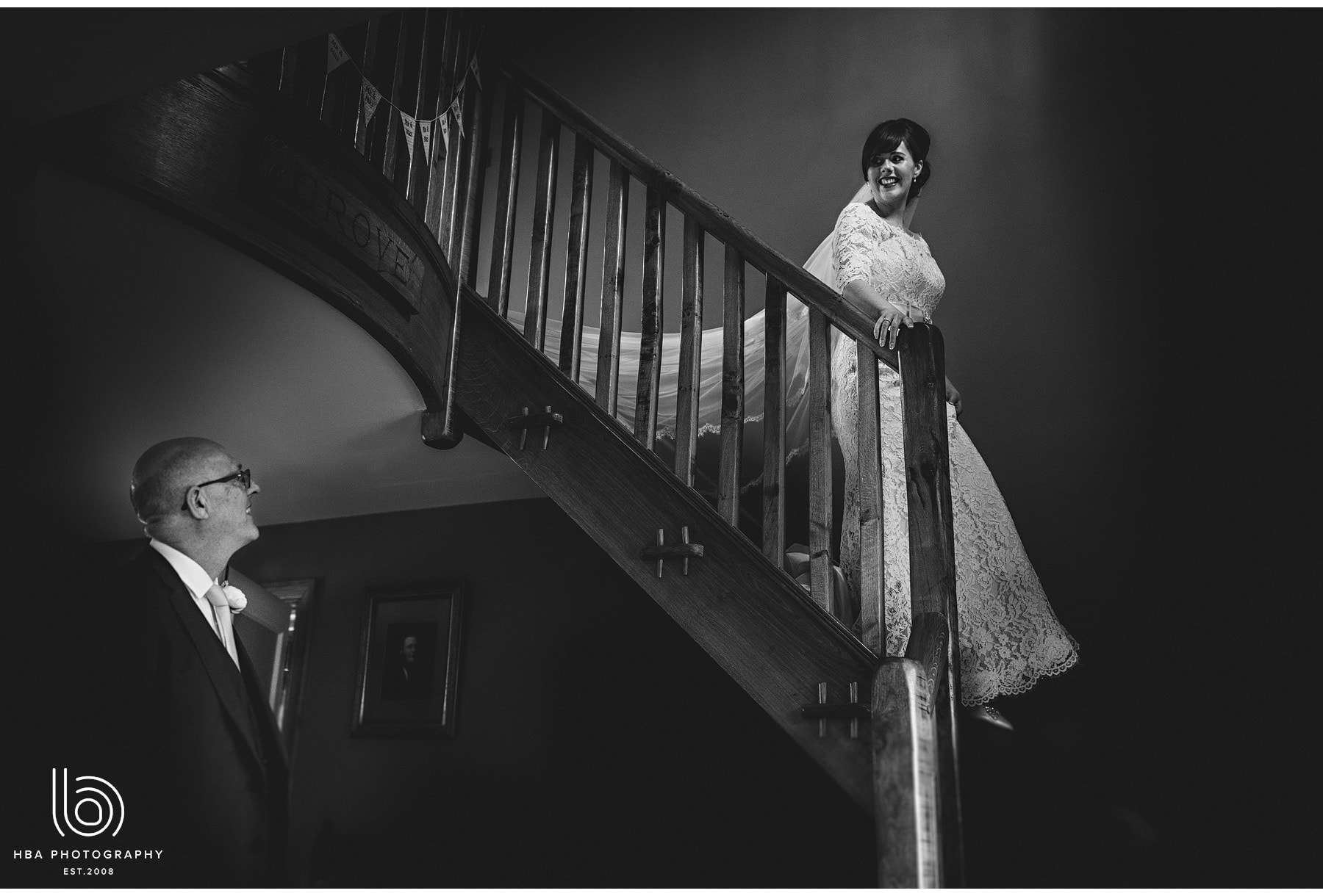 the bride coming down the stairs to see her dad