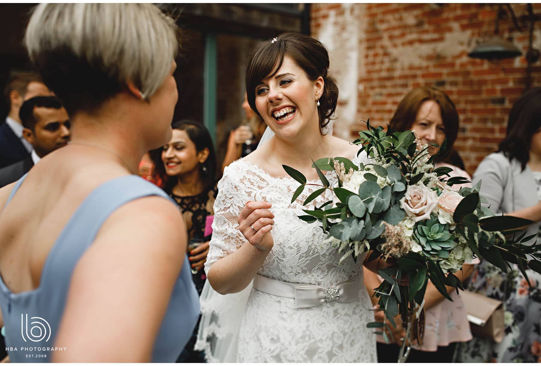 the bride laughing with guests