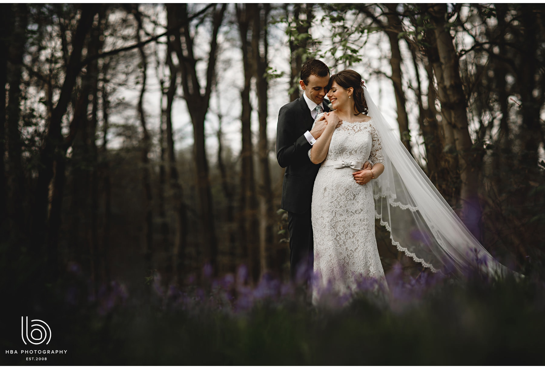the bride & groom in the bluebells