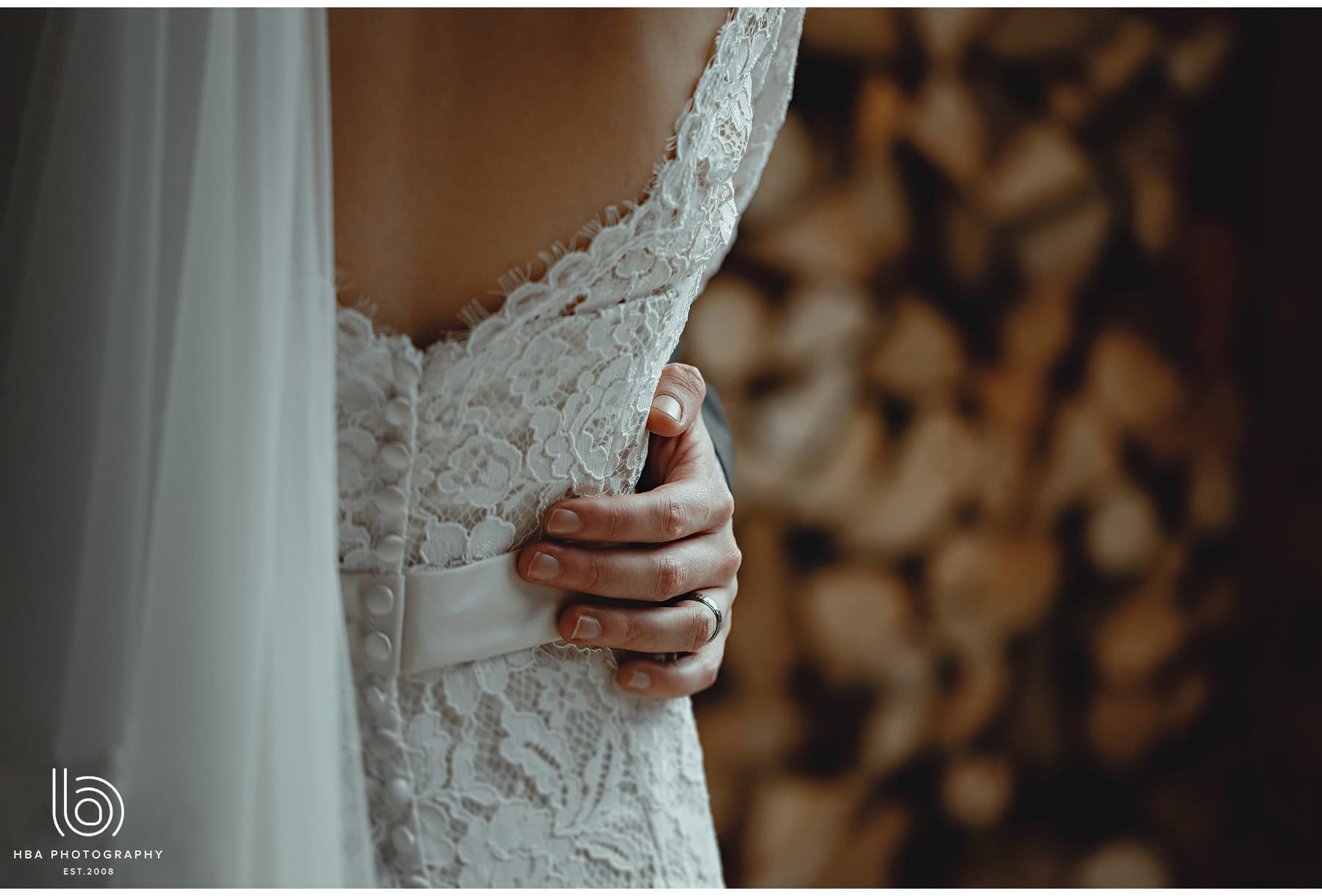 the groom hand on the bride's waist