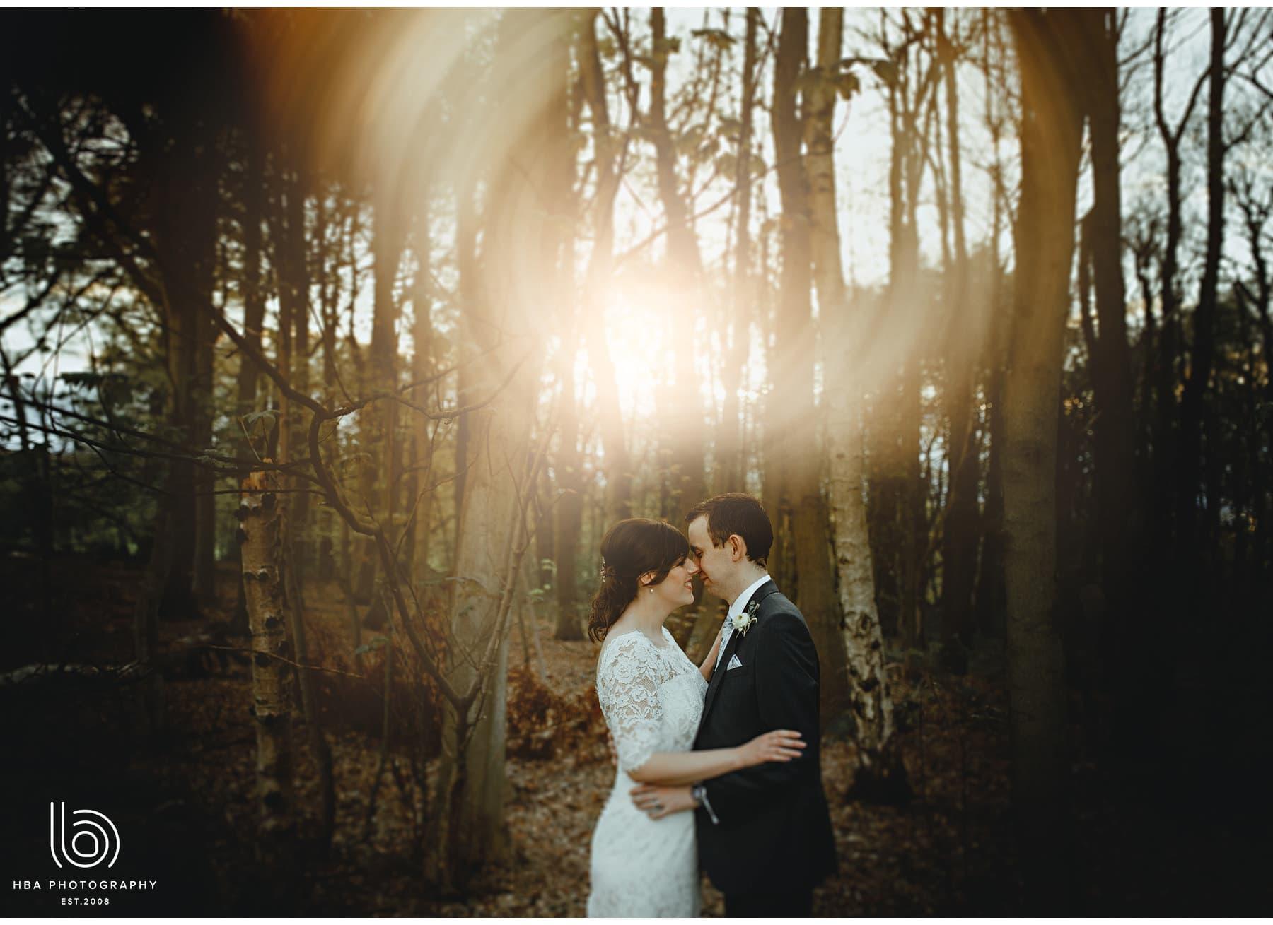 the bride & groom in the woods in golden hour