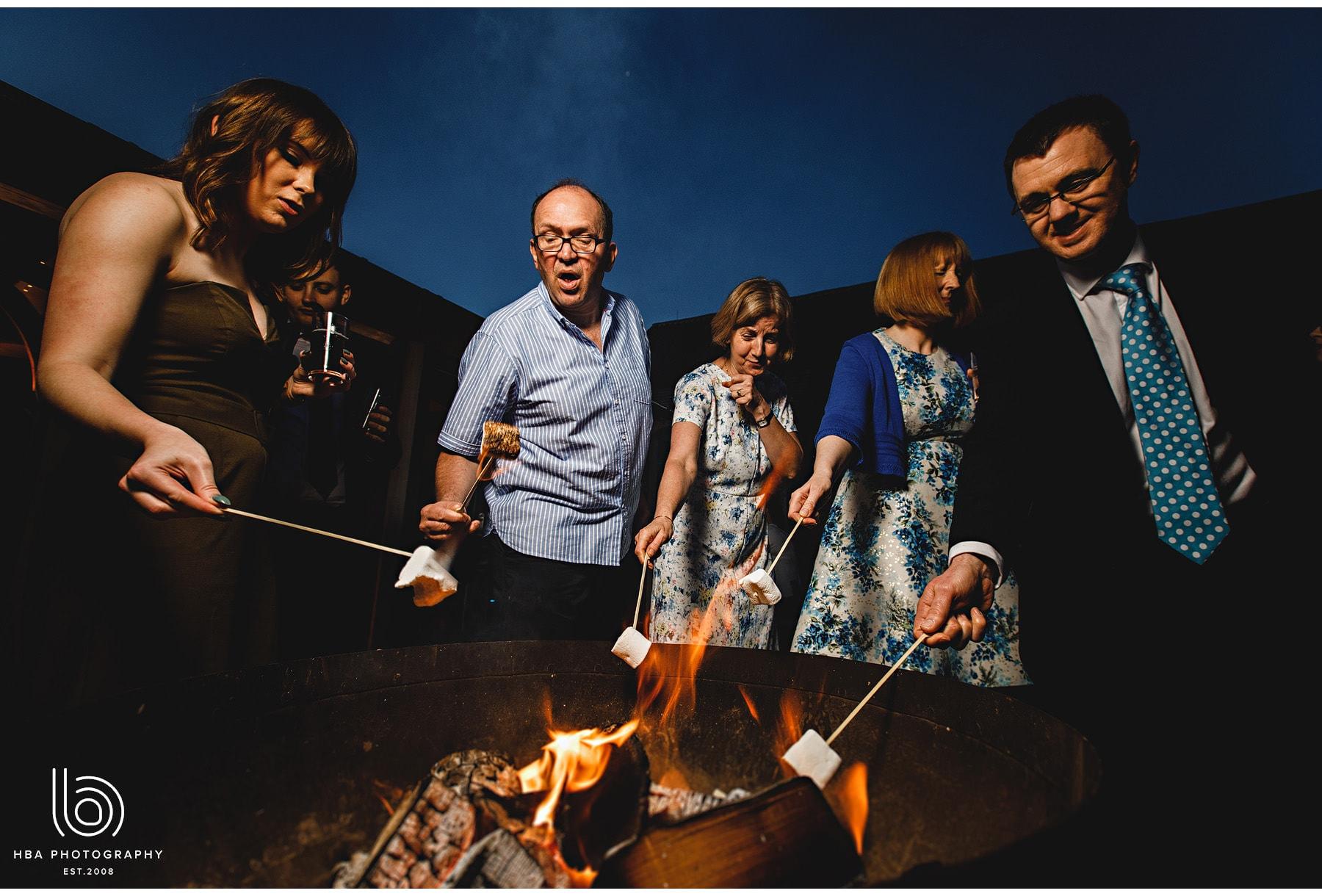 wedding guests roasting marshmallows