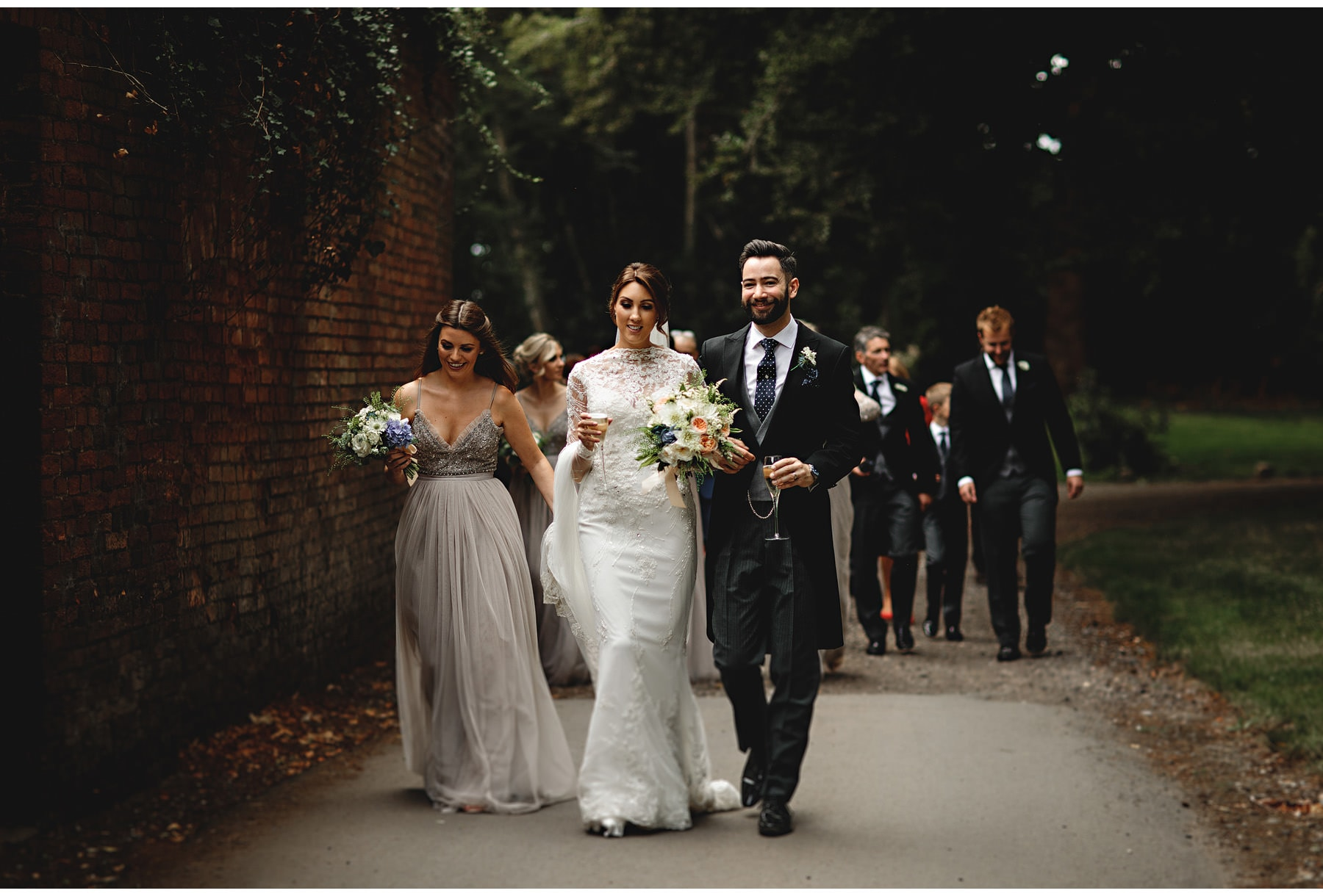 the bride and groom walking at Dprfold hall