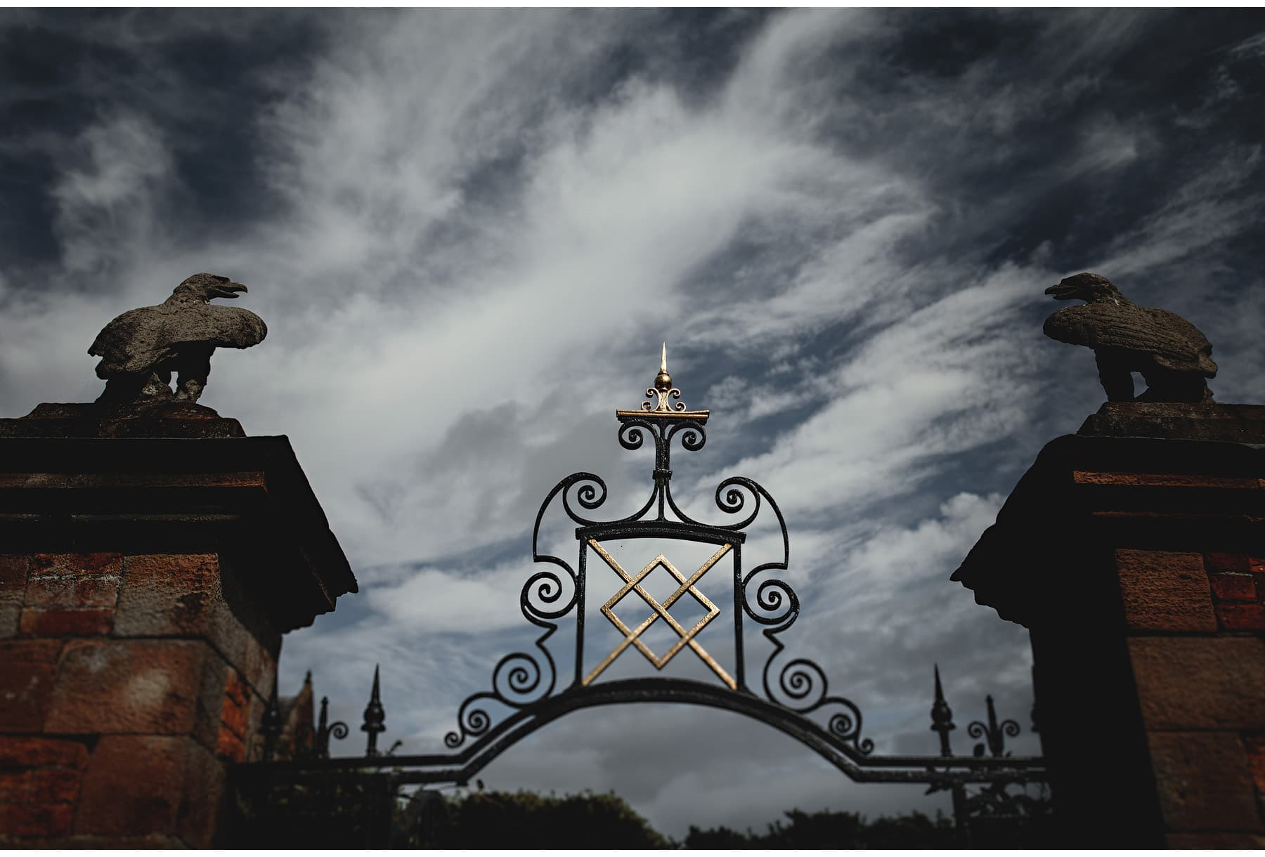 the gates against the dramatic sky
