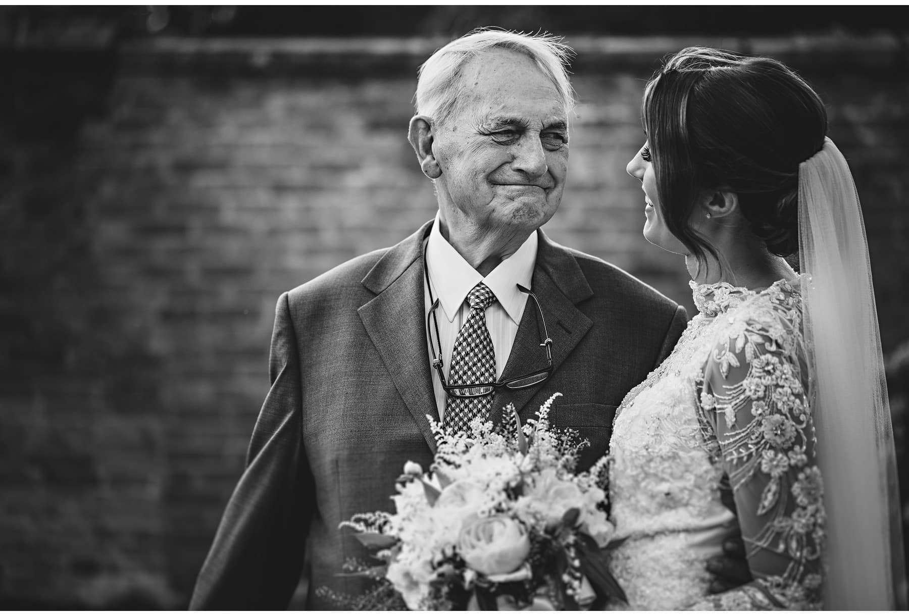 grandad looking lovingly at the bride