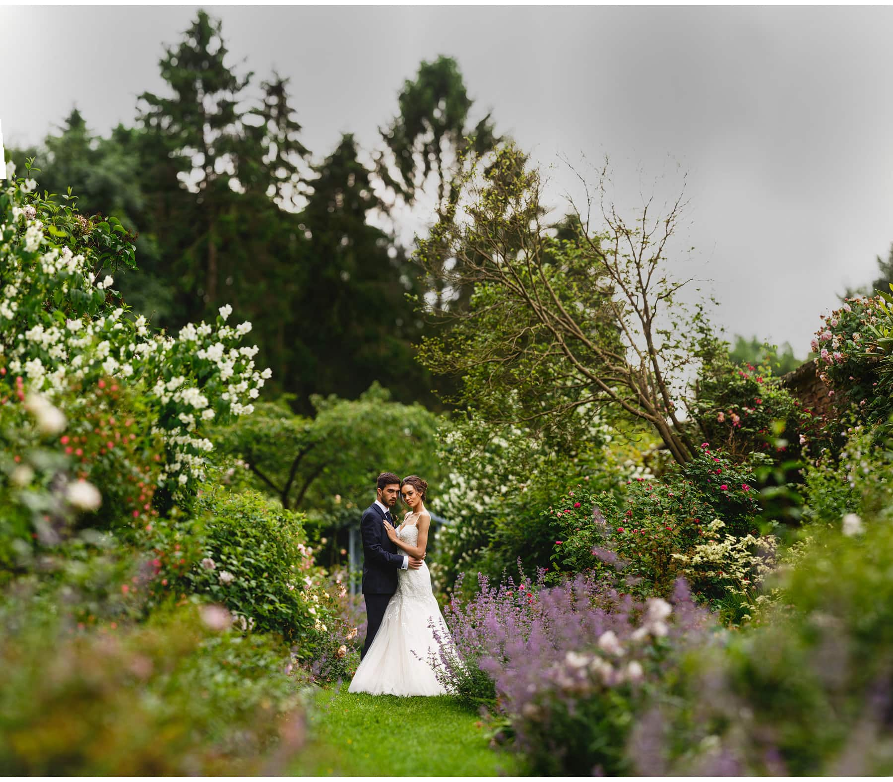 the bride and groom in the summer gardens
