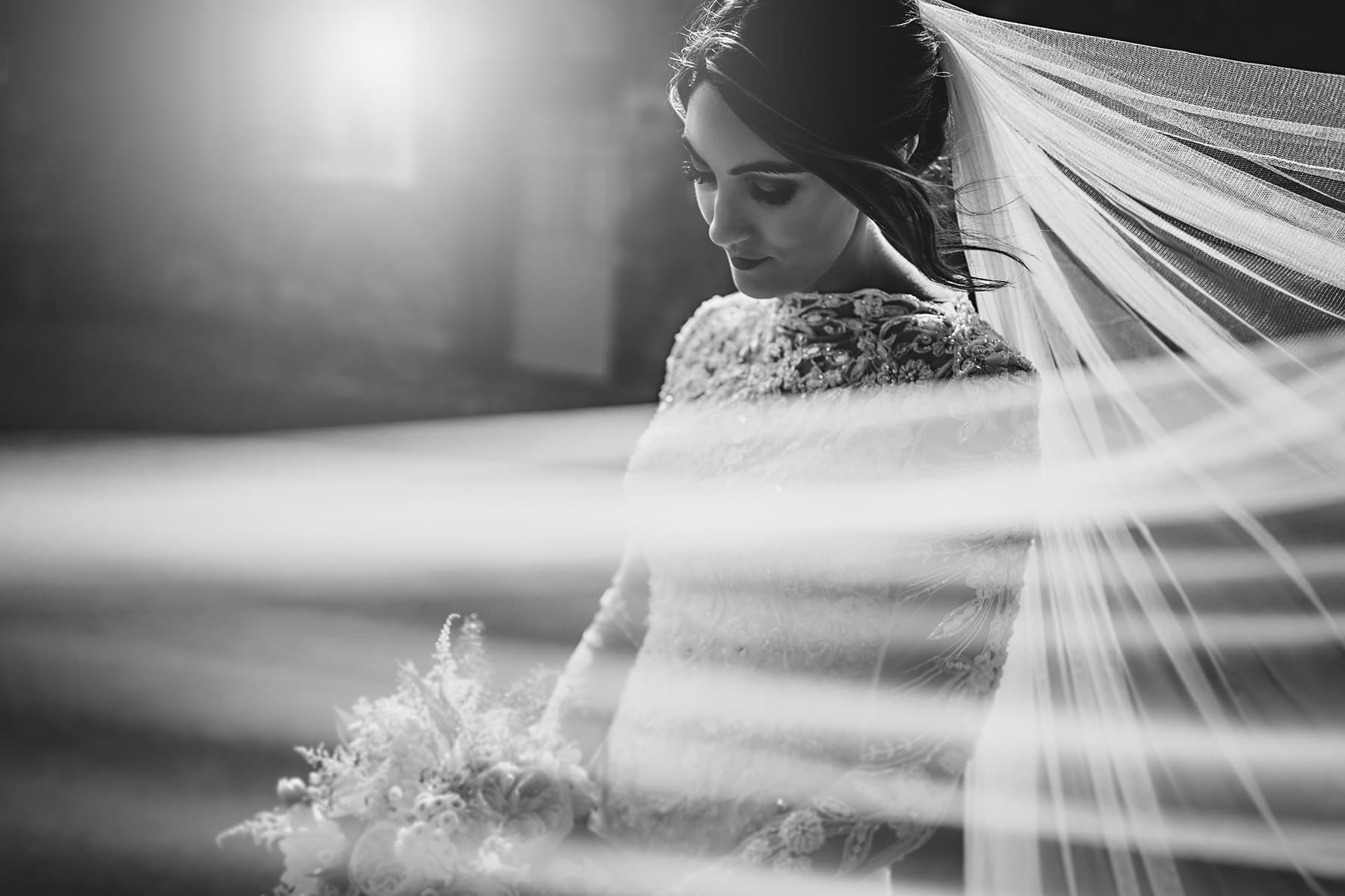 The bride at Dorfold Hall with her veil blowing in the wind