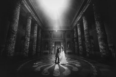 a bride and groom dancing at kedleston hall on their wedding day
