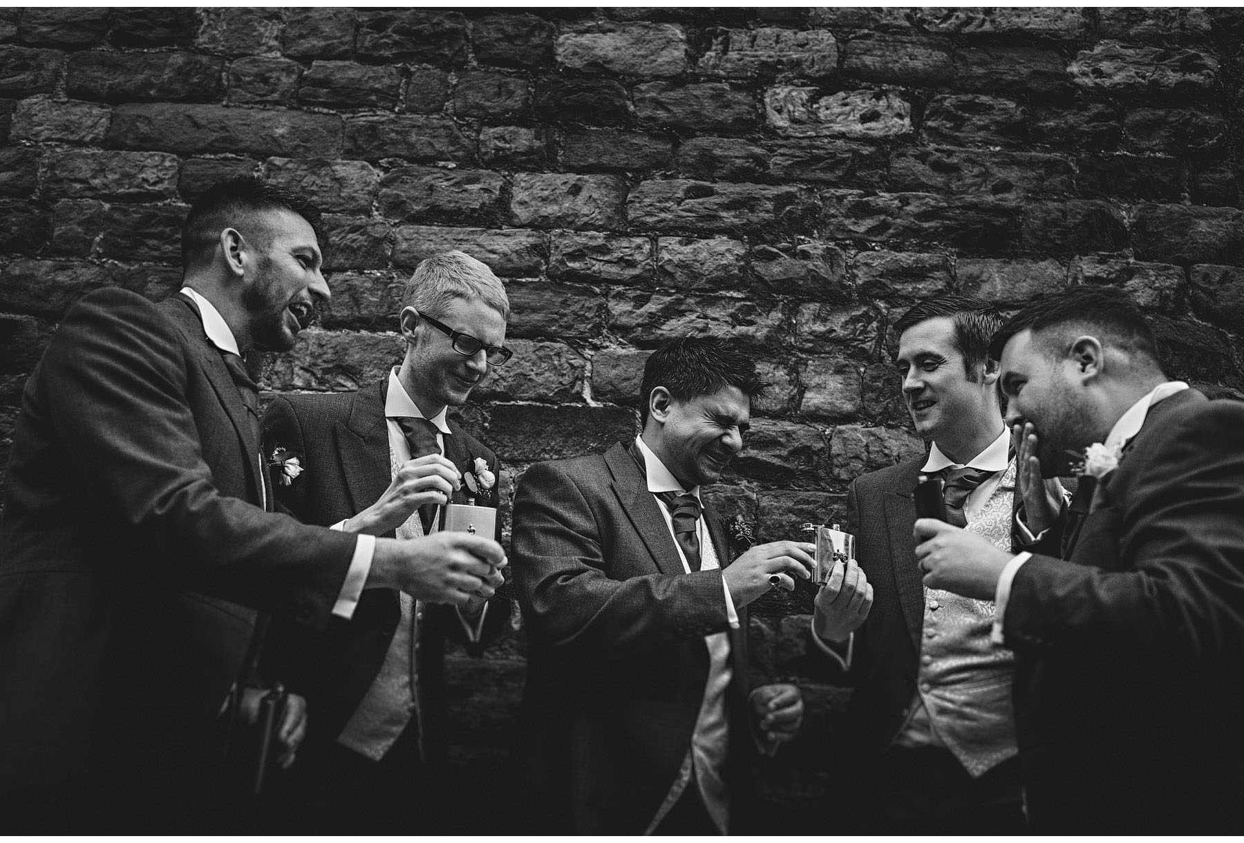 the groom and his men with hip flasks