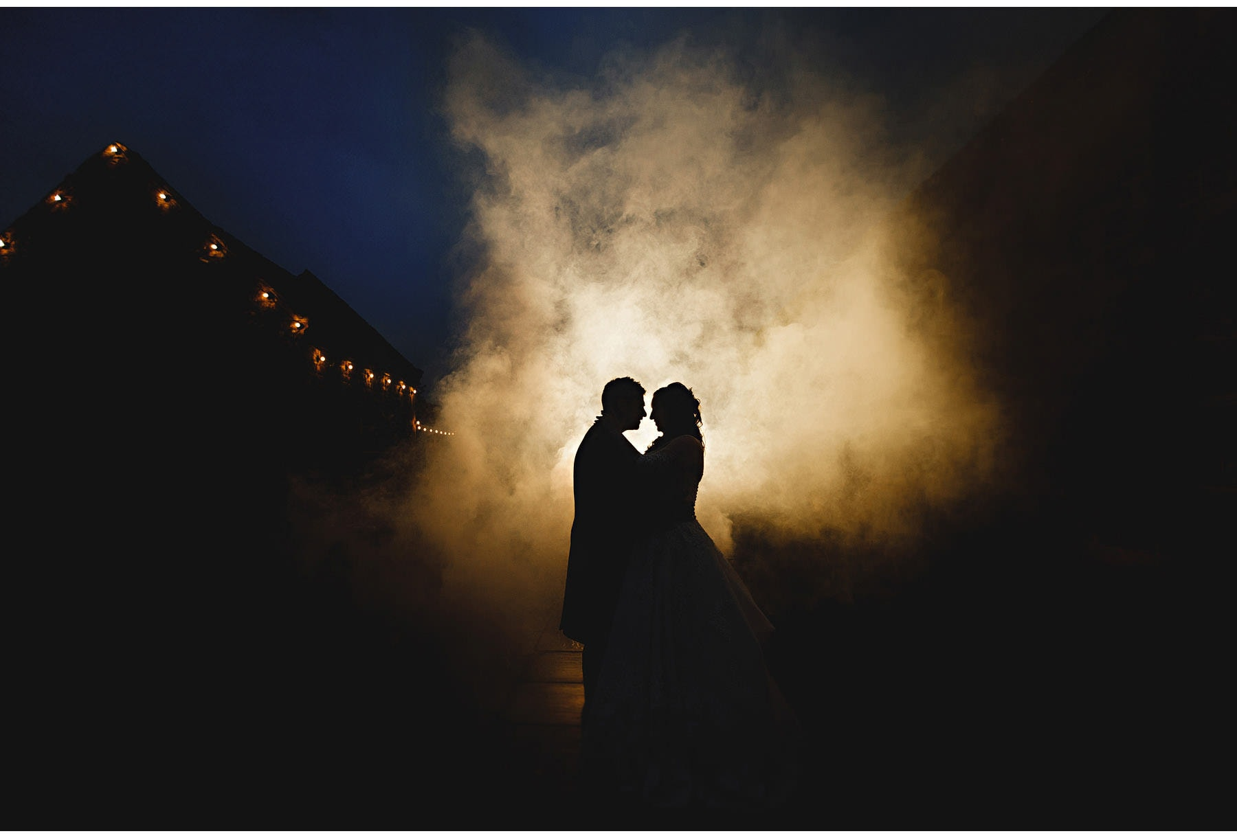 The bride & groom in the mist at night