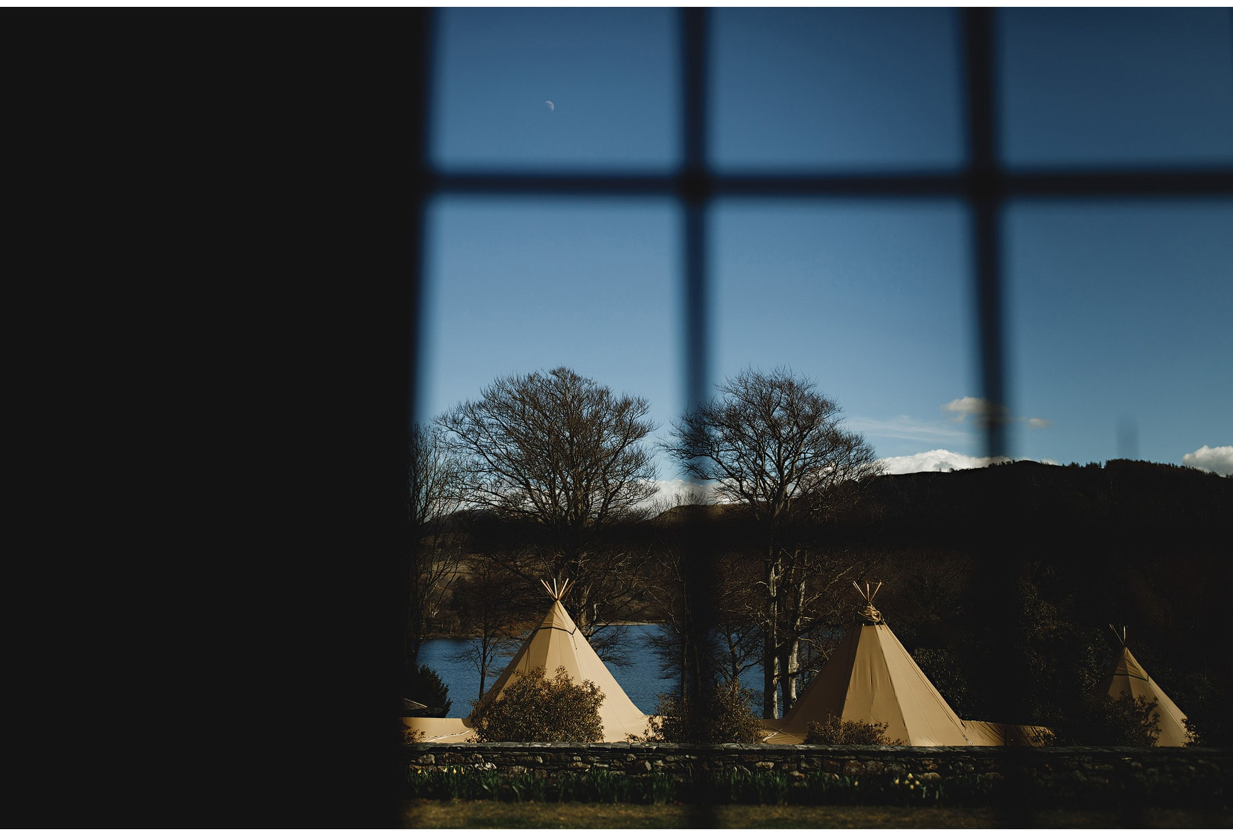 A view of a tipi with Derwent water in the background