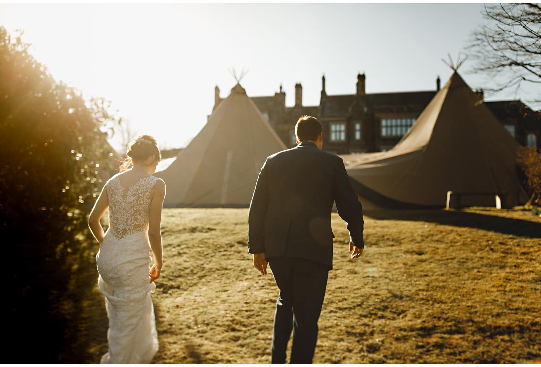 The bride & groom walking back to the tipi on the edge od Derwent water