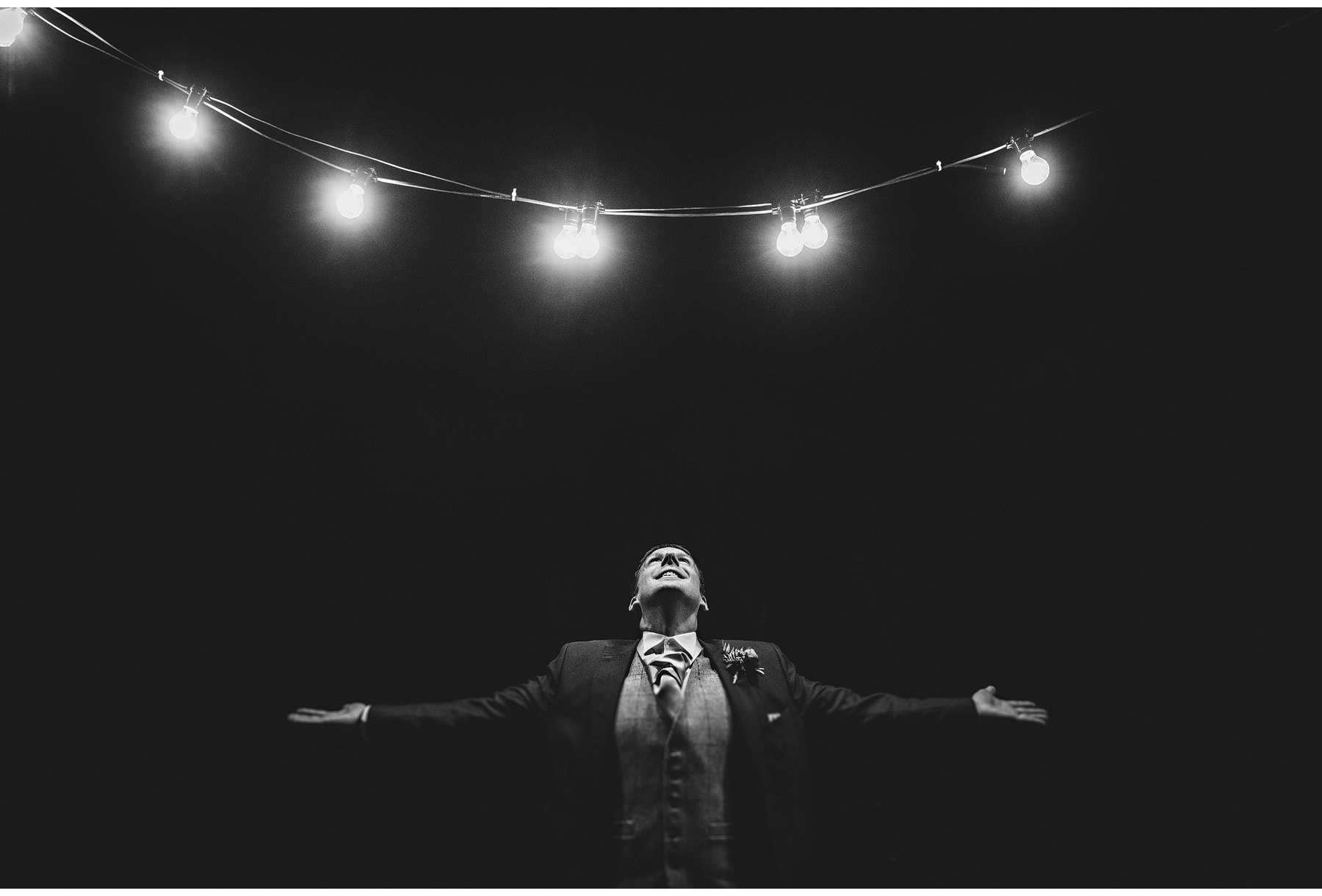 a groom under the lights