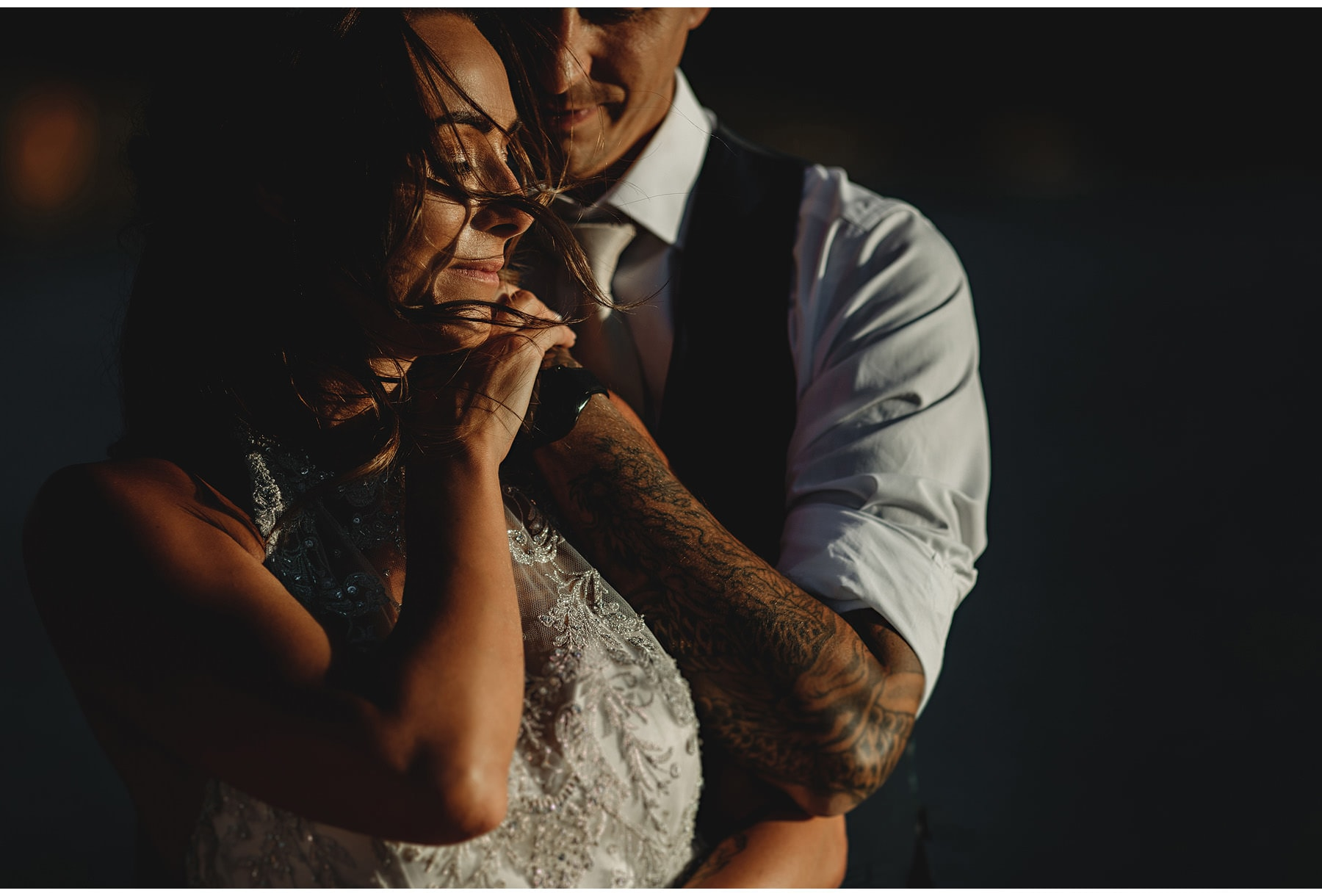 a tattooed groom with his wife