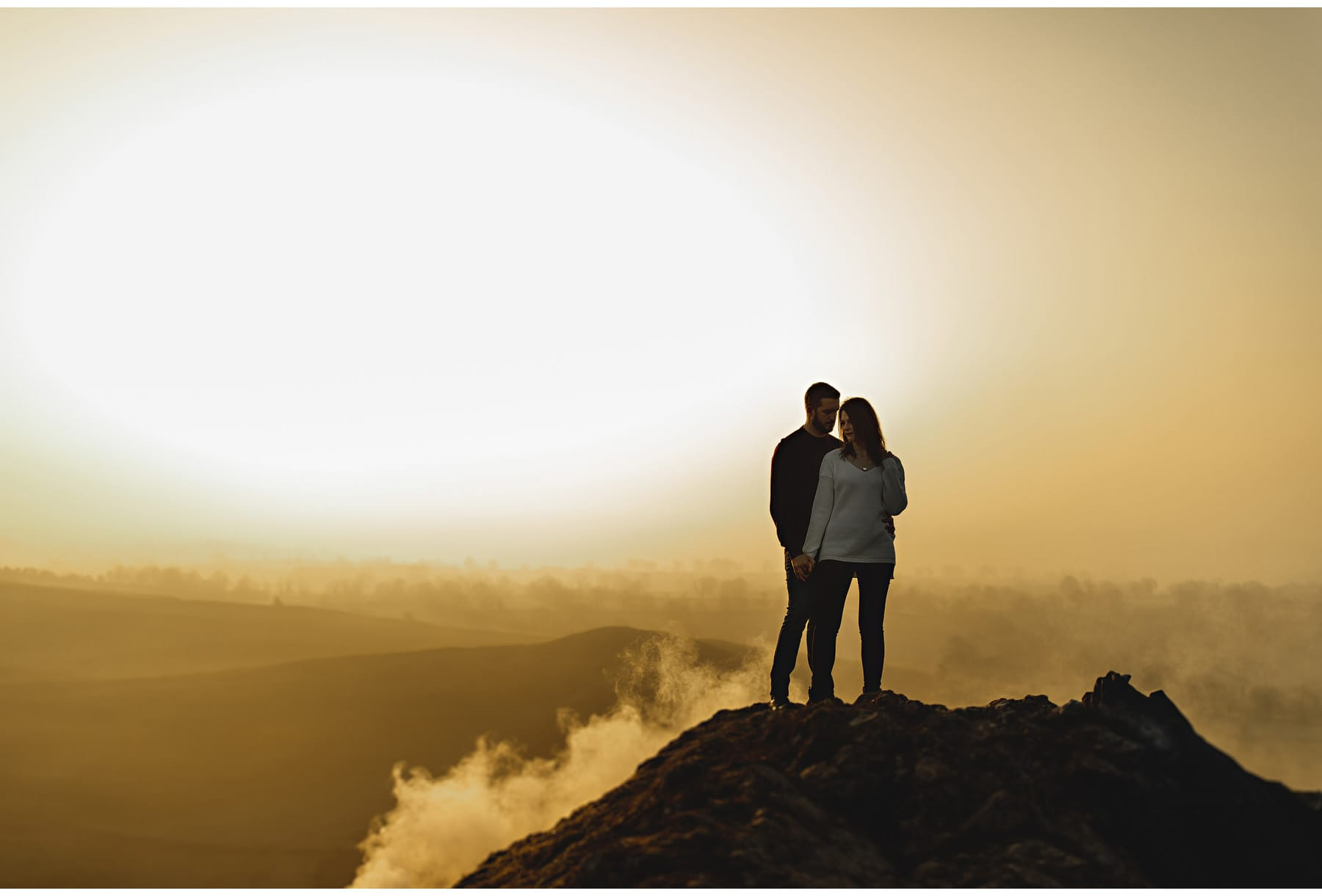 a couple at the top of Helwellyn
