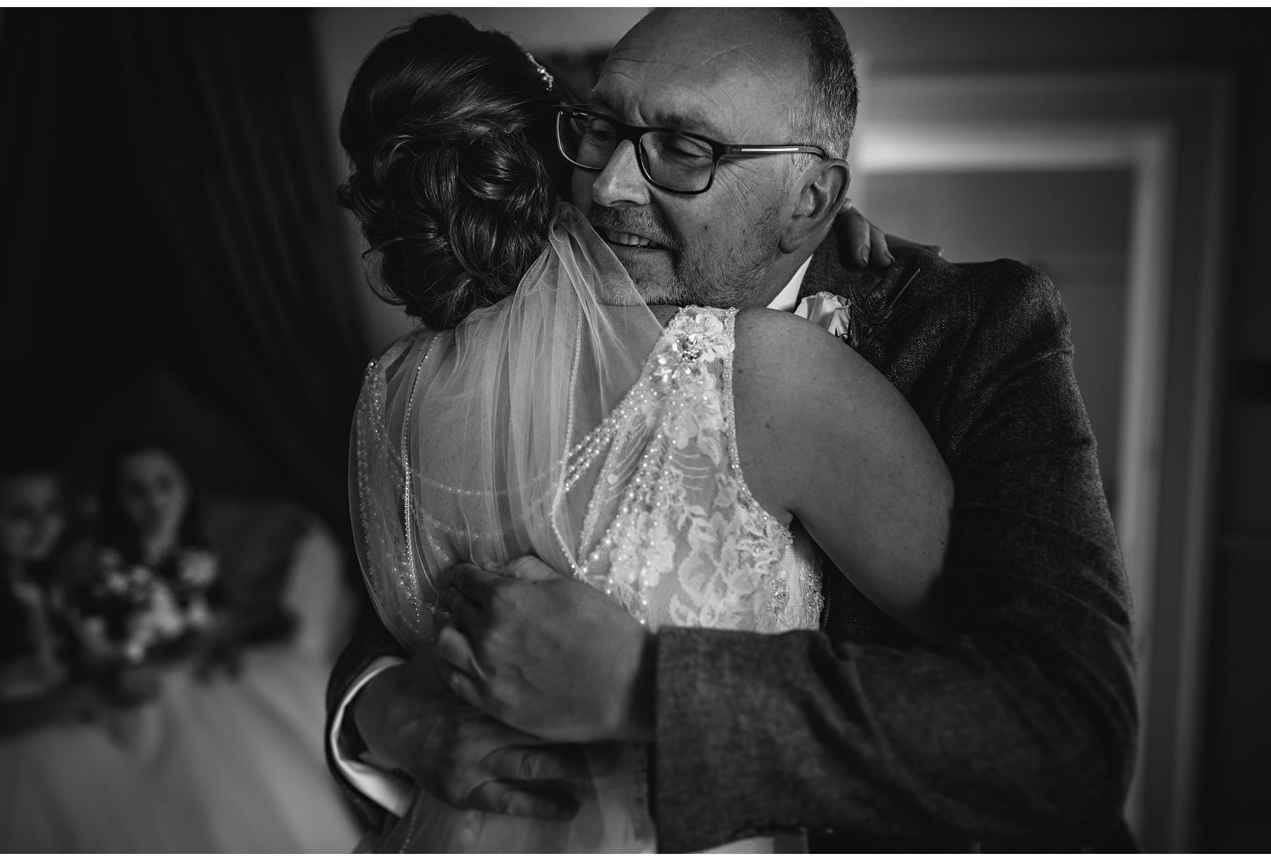the bride hugging her dad