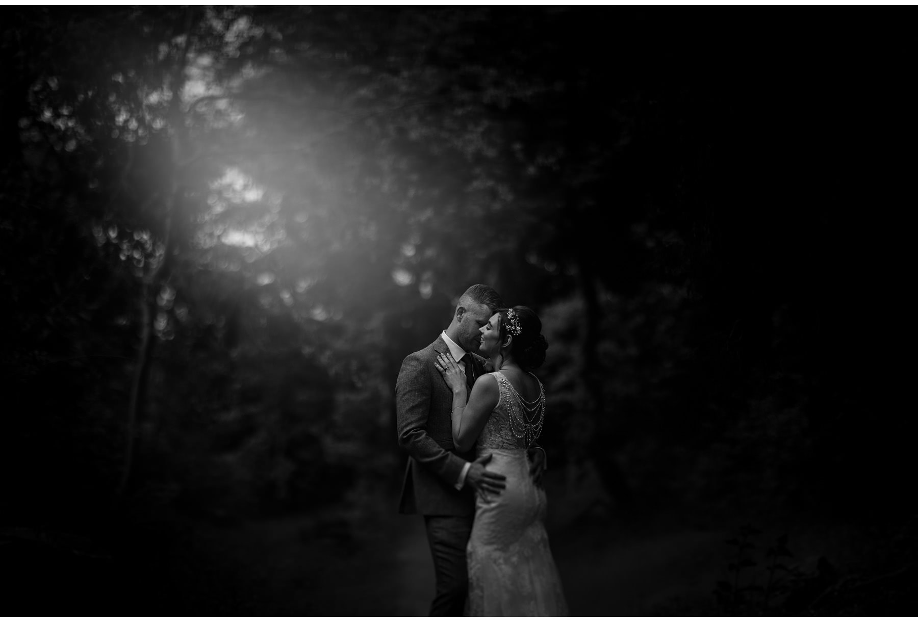 the bride & groom in the woods