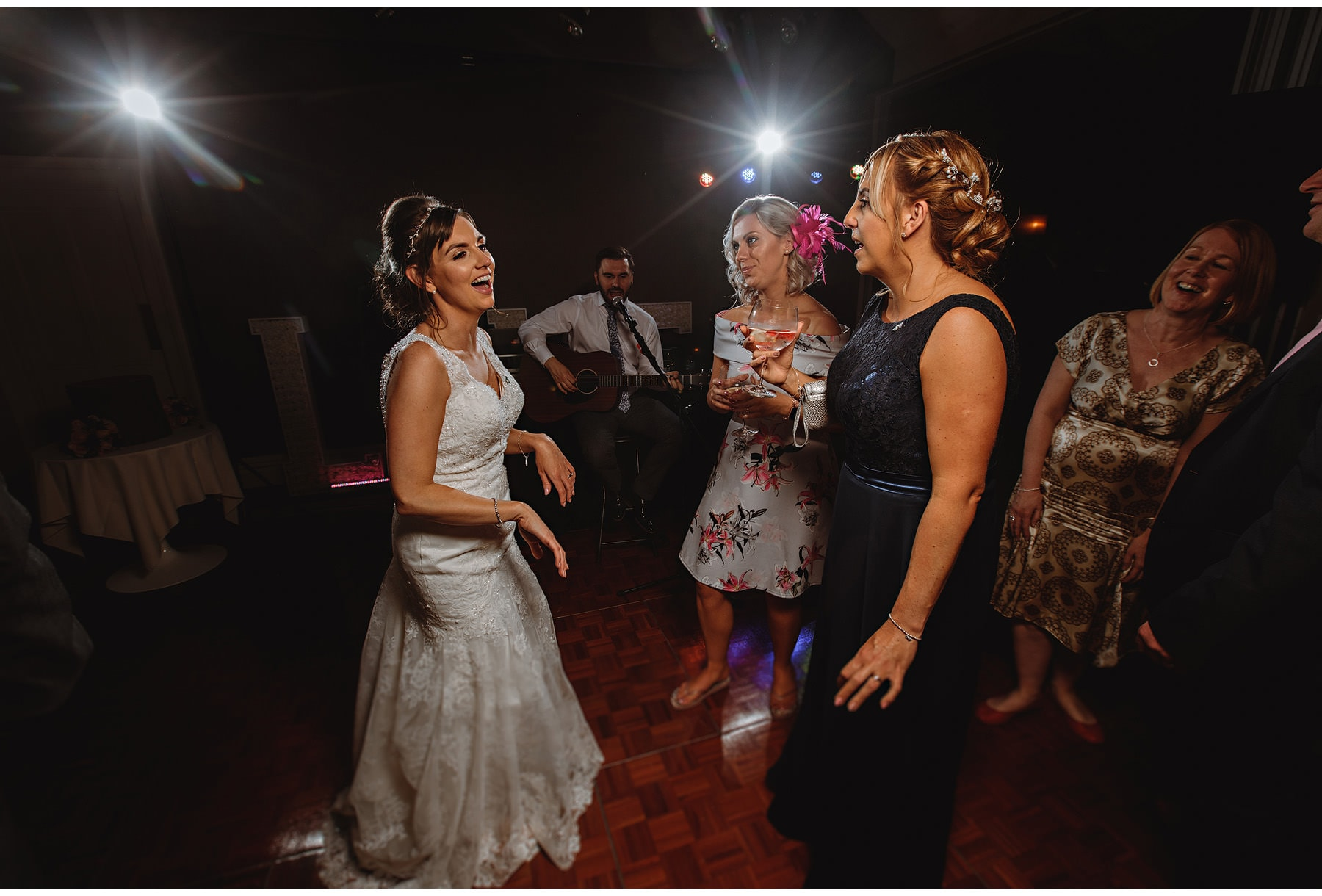 the bride dancing with her friends