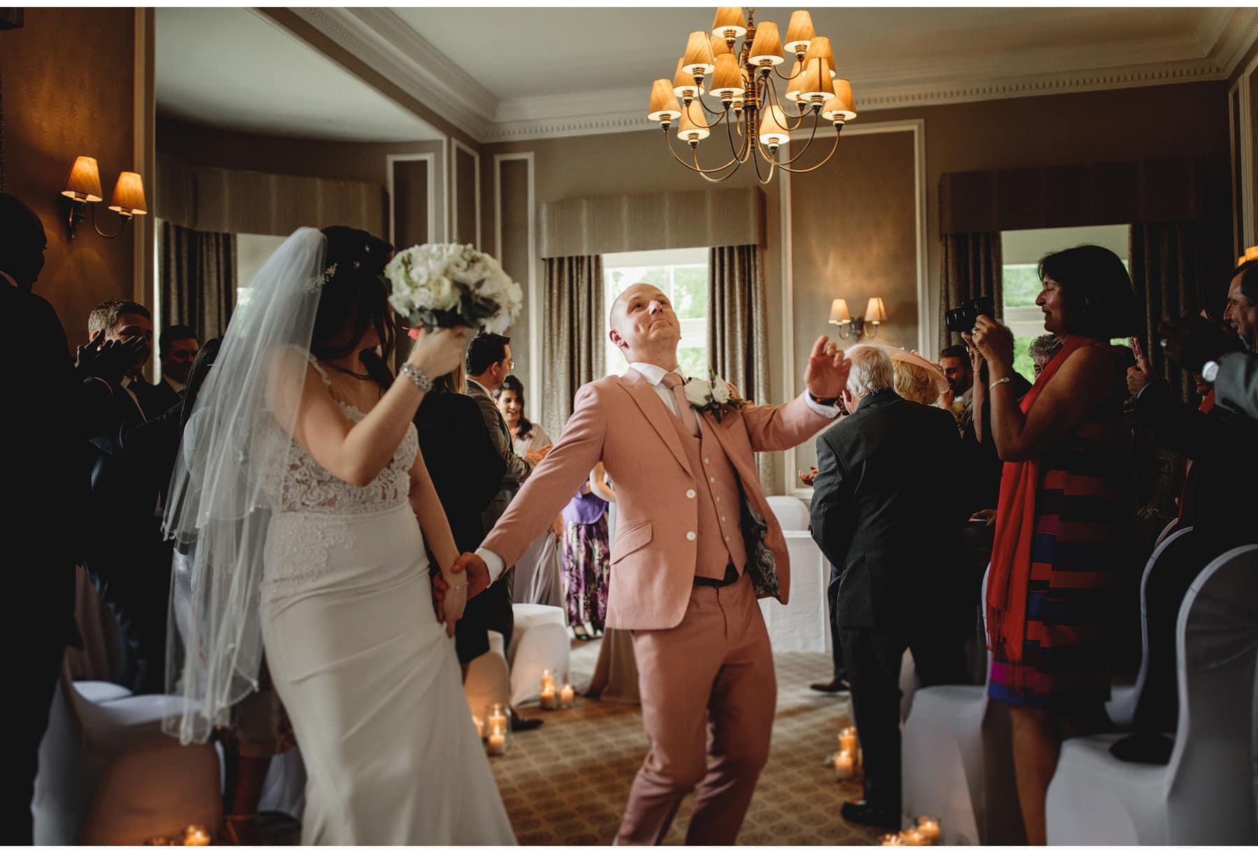 the bride & groom celebrating walking down the aisle