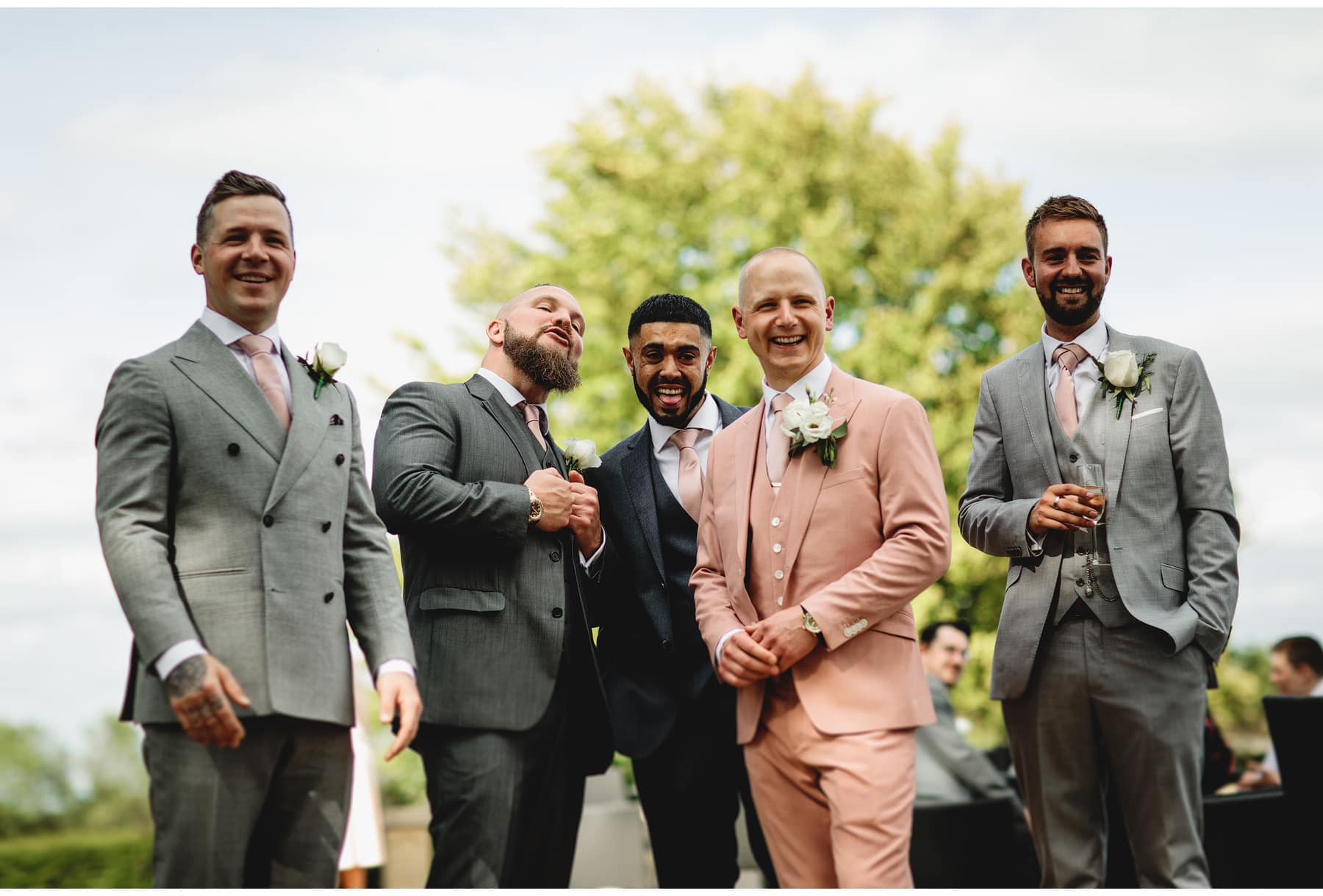 the groom in his pink suit
