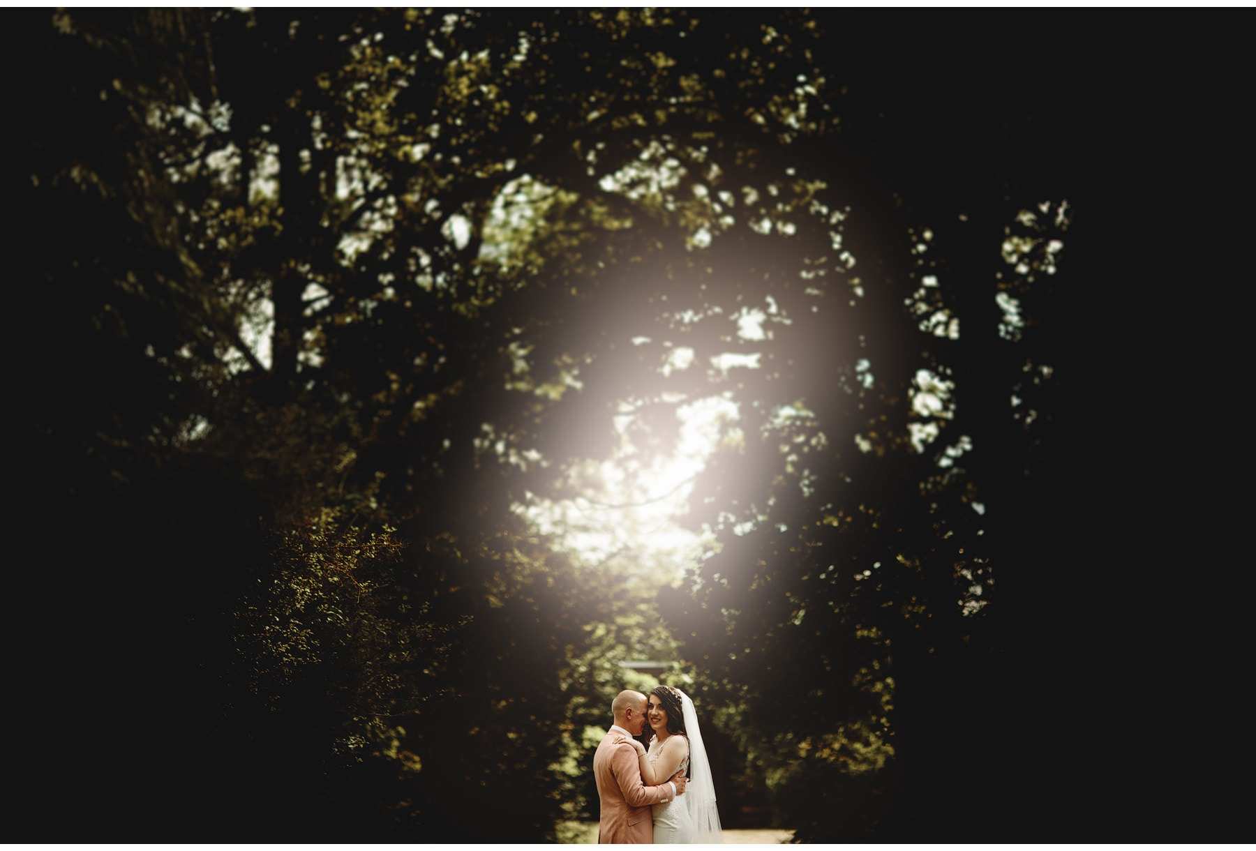 the bride & groom in sun flare