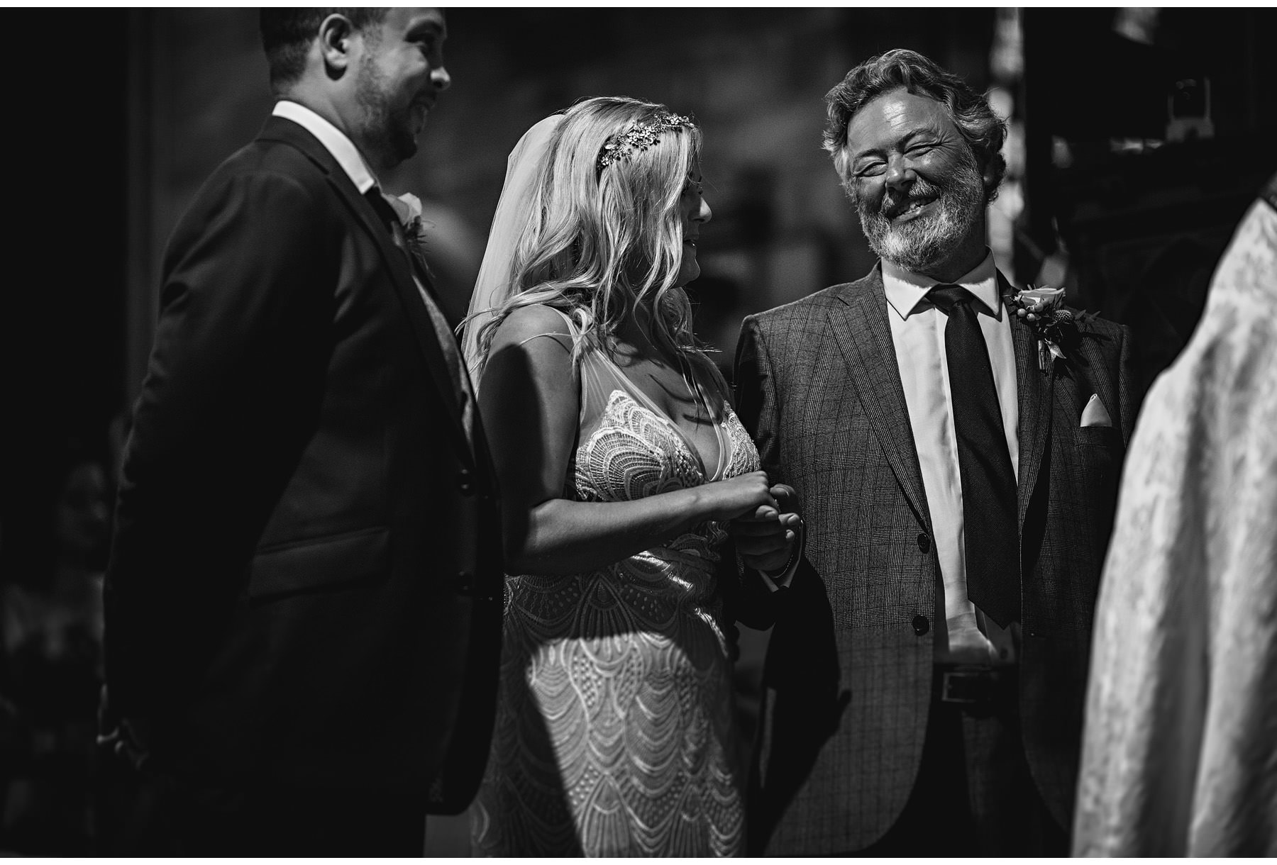 the father of the bride smiling during the wedding ceremony