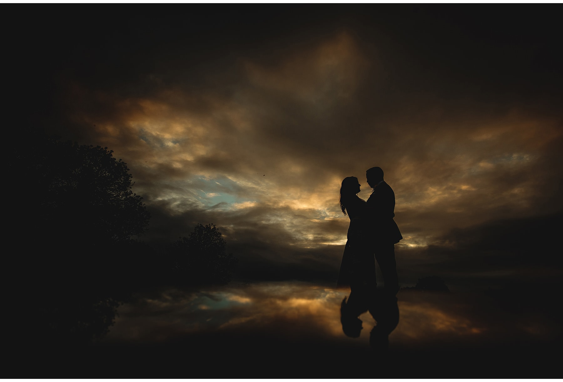 The bride & groom in the silhouette sky