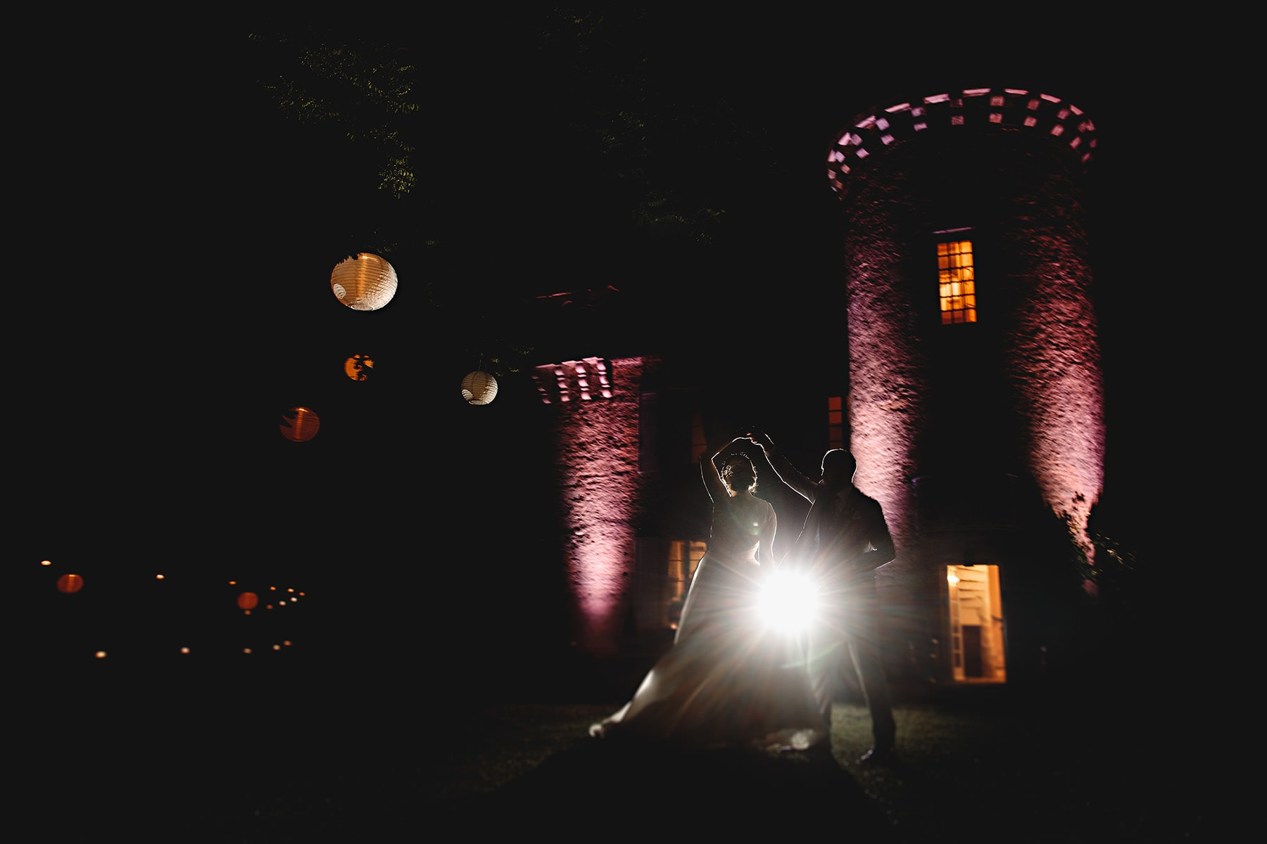 nighttime photos of the bride and groom dancing at the chateau cazenac in the dordogne