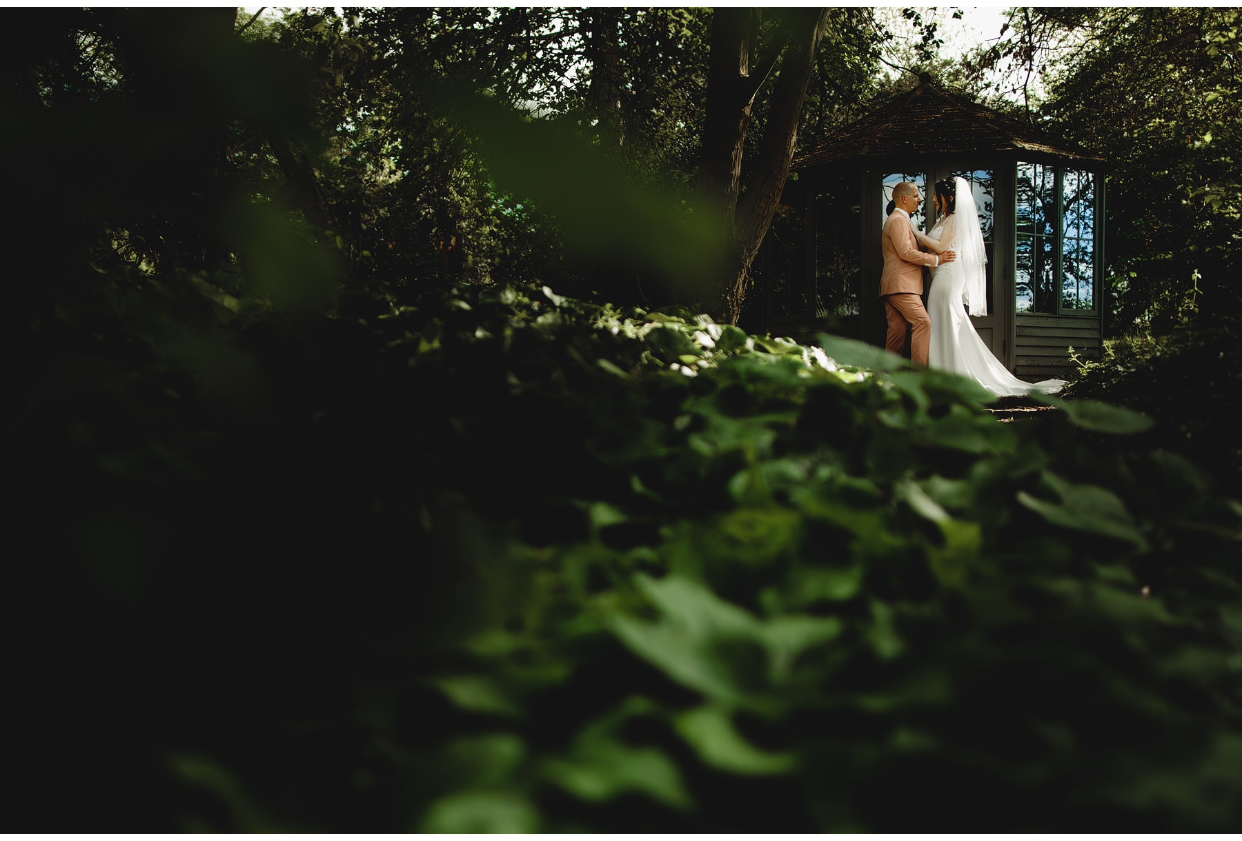 the bride & groom in the grounds of Hothorpe Hall after their wedding