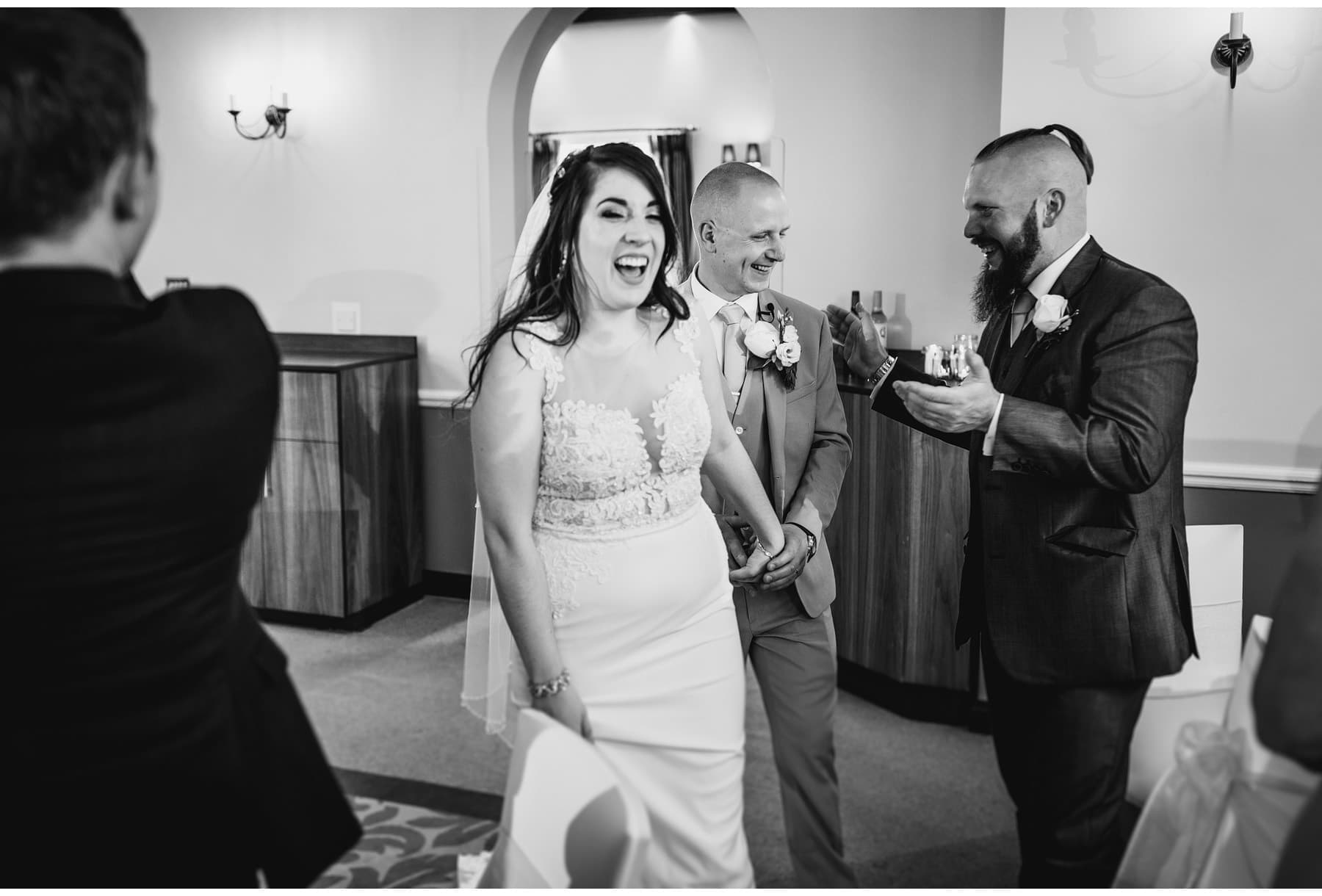 the bride & groom walking into their wedding breakfast