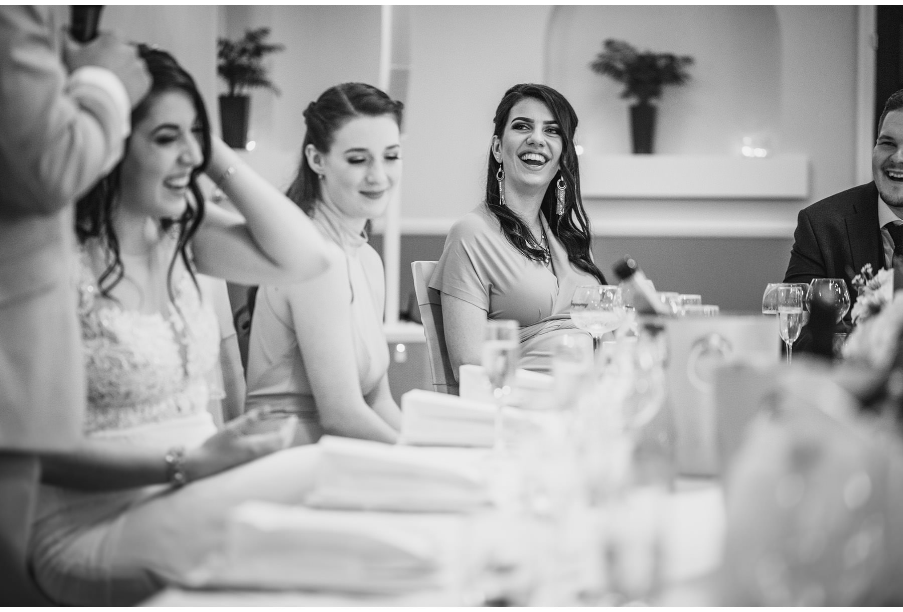 wedding guests laughing at the wedding speeches