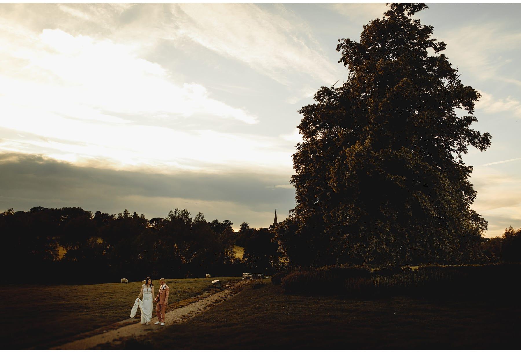 Horthorpe Hall wedding photos, the bride & groom in the evening sunshine