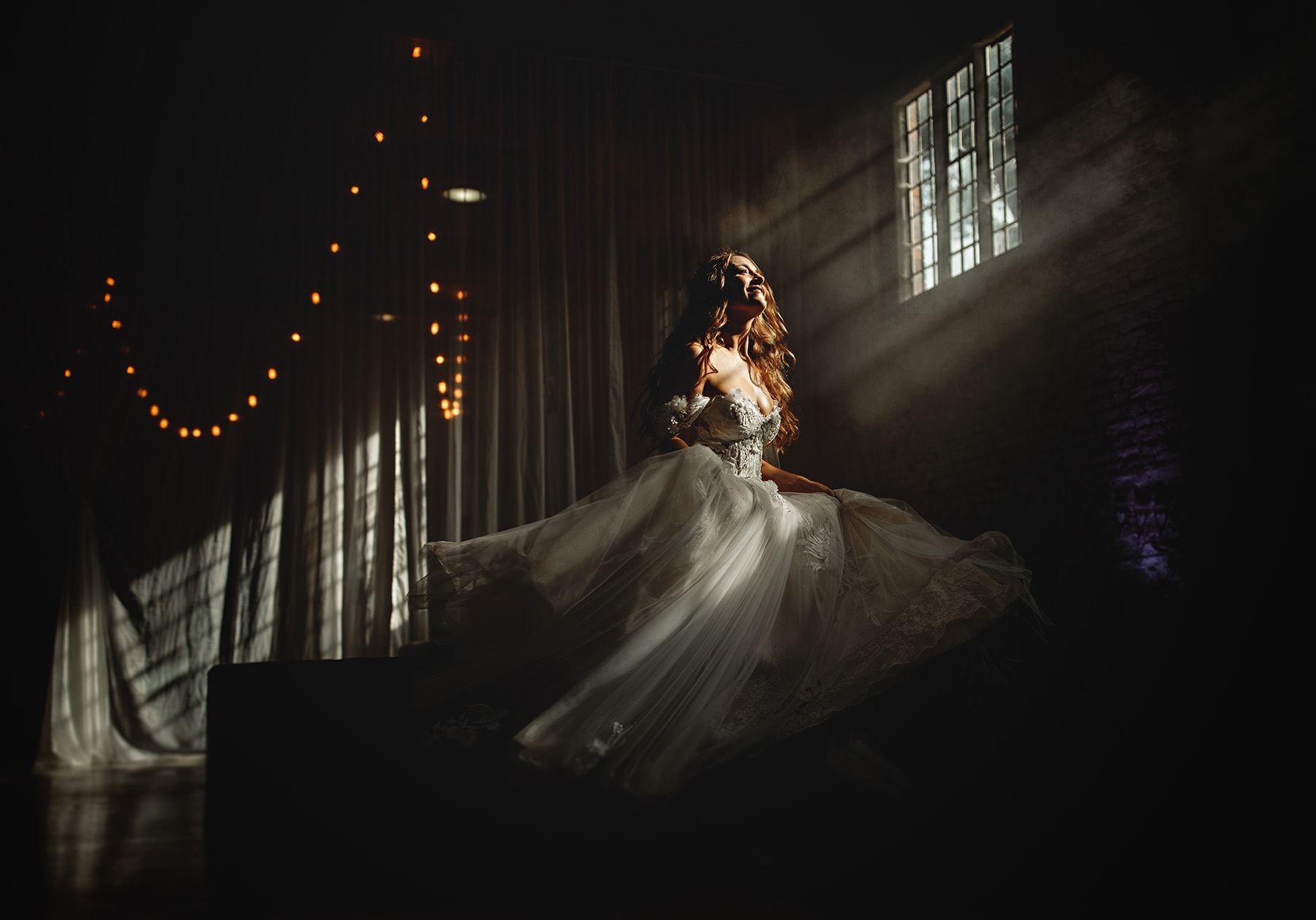 the bride spinning in dark light at Calke Abbey. Another stunning derbyshire wedding venue
