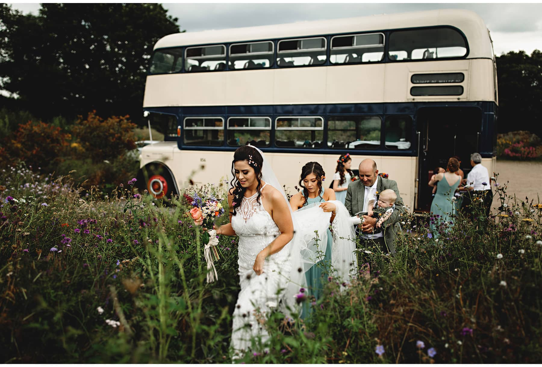 the bride walking from the vintage bus to the ceremony