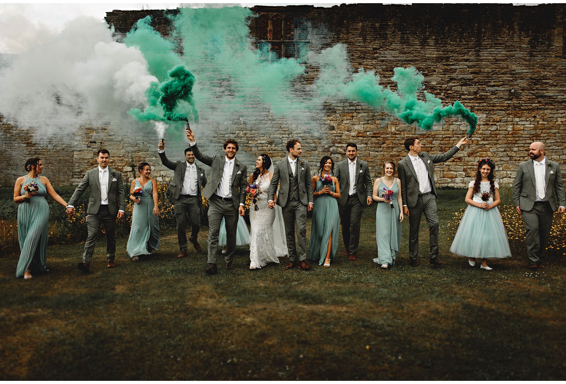 the bridal party with smoke bombs