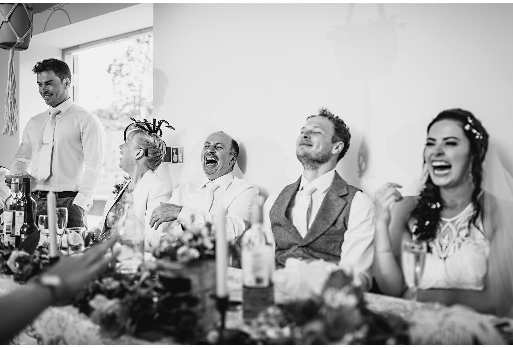 people laughing during the speeches