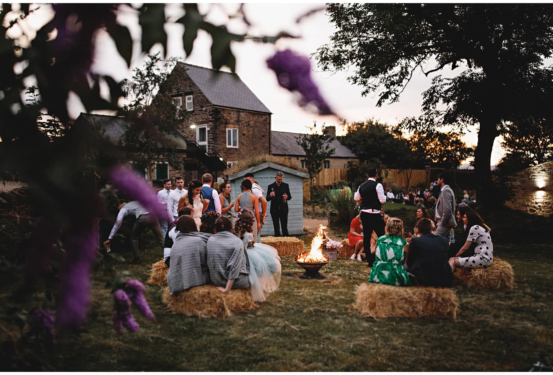 wedding guests sat round the fire