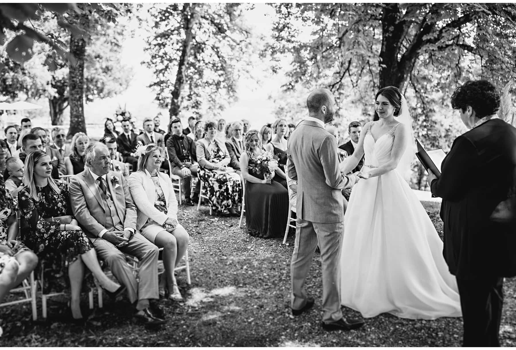 the bride & groom in the outdoor ceremony