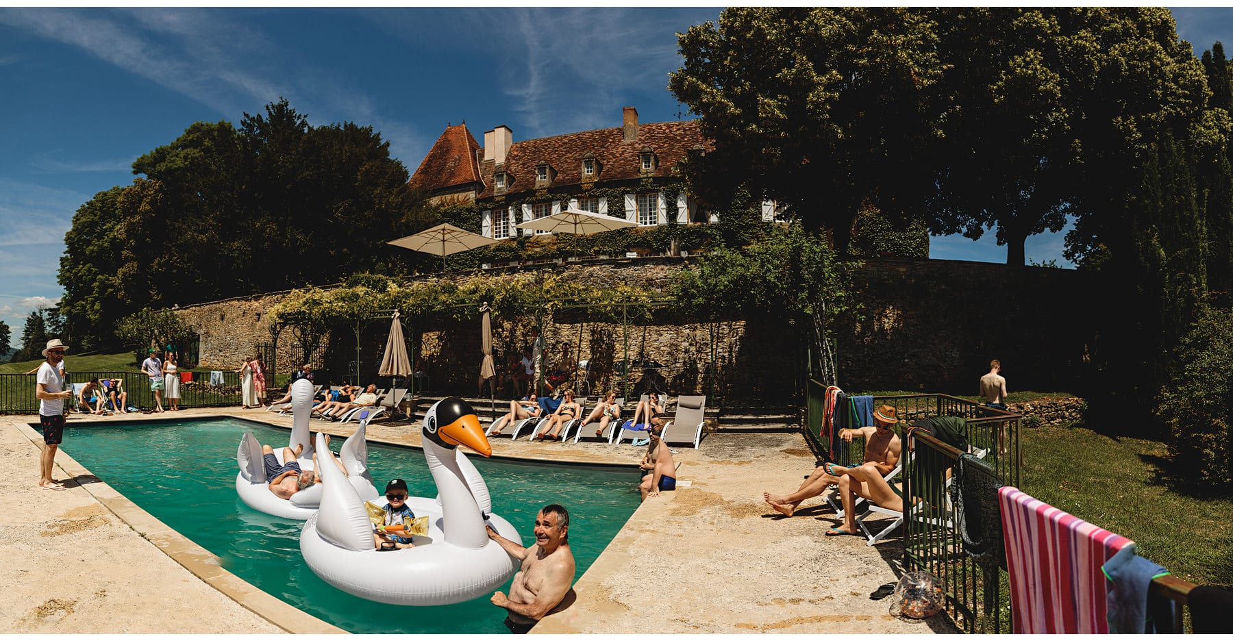 Everyone enjoying the pool at Château Cazenac
