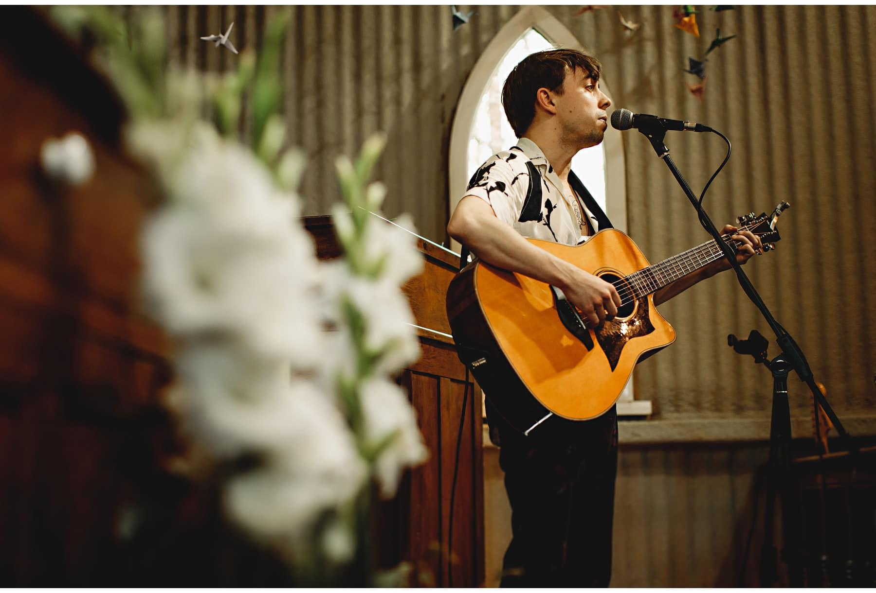 a guitarist singing