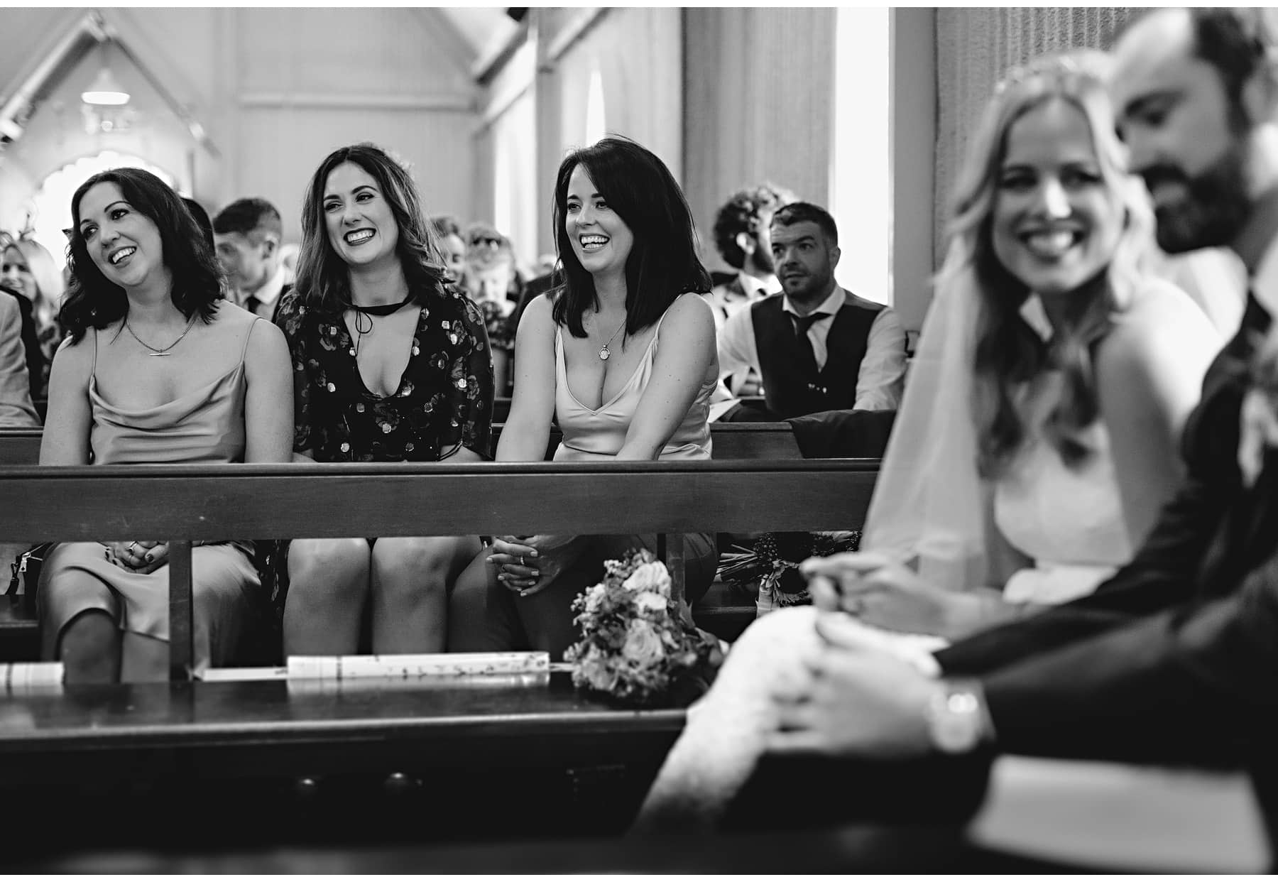 everyone smiling during the wedding ceremony